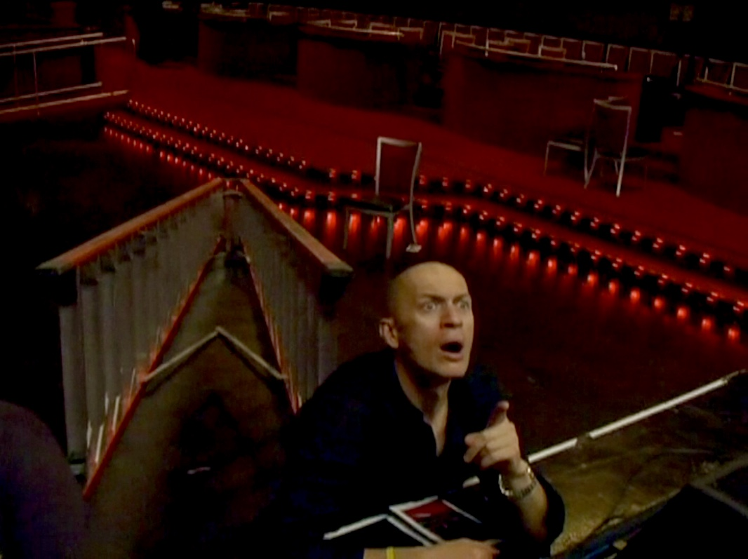 Mime Max Fomitchev during load-in for GLAD & Sprint Relay's 2007 concert  Beethoven's Nightmare Live At The El Rey , produced by Bob Hiltermann, John Drouillard, and Natalie Drouillard.  Still from Worldplay, Inc.'s 2010 feature documentary,  See What I'm Saying , cinematography by Jeff Gatesman, directed by Hilari Scarl.