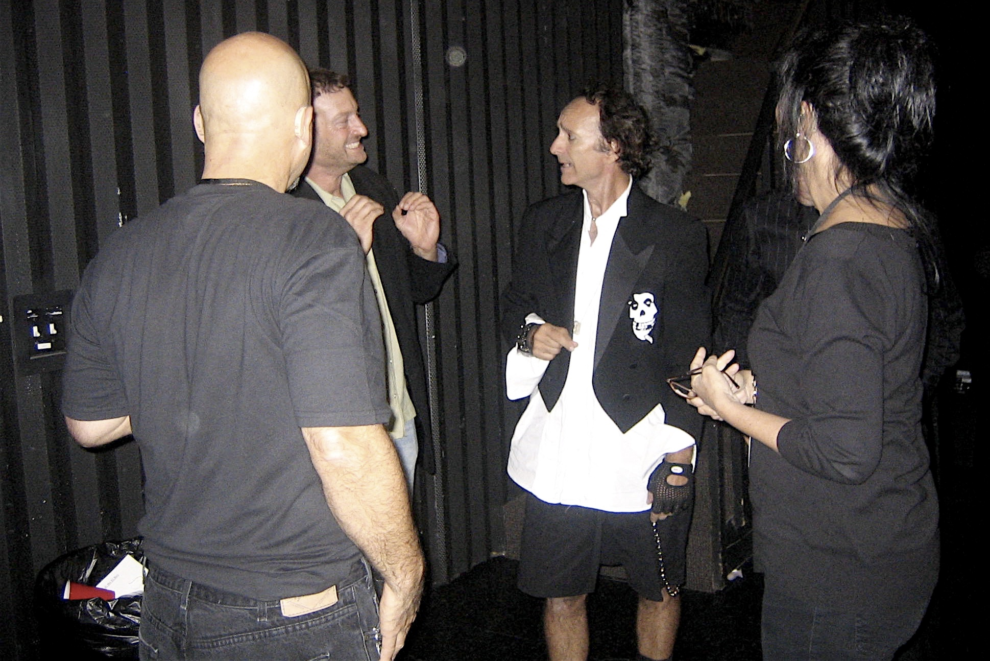 Actor Troy Kotsur with Beethoven's Nightmare members Steve Longo, Ed Chevy, and choreographer Rita Corey backstage after GLAD & Sprint Relay's 2007 concert  Beethoven's Nightmare Live At The El Rey , produced by Bob Hiltermann, John Drouillard, and Natalie Drouillard.  Photo by Natalie Drouillard.