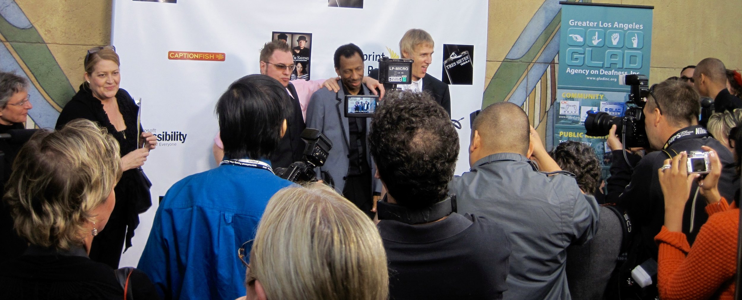 Actors Robert DeMayo, CJ Jones, and Beethoven's Nightmare drummer Bob Hiltermann at the Egyptian Theatre for the premiere of Wordplay, Inc.'s feature documentary  See What I'm Saying , directed by Hilari Scarl.  Photo by John Drouillard.