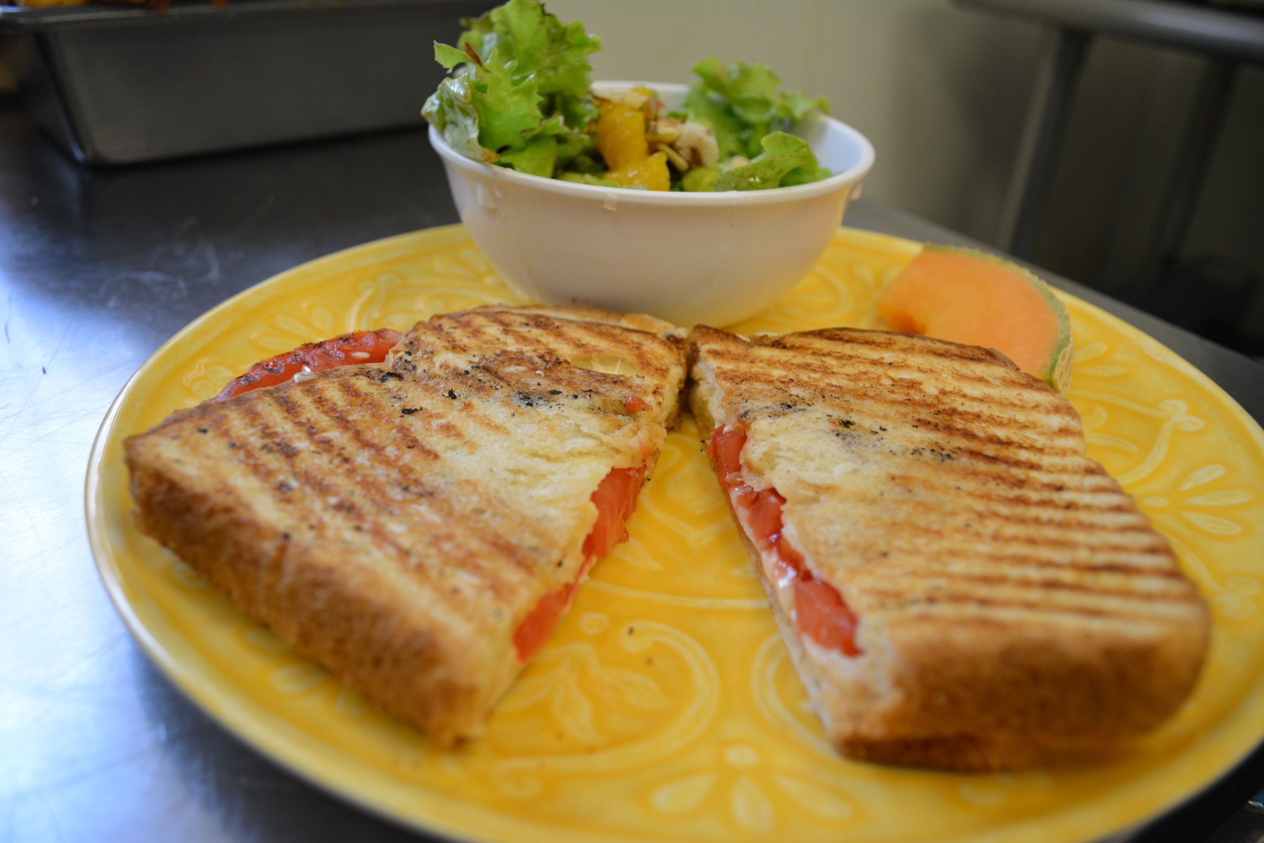Baba's Grilled cheese - Melted American cheese and slices of a red ripe tomato