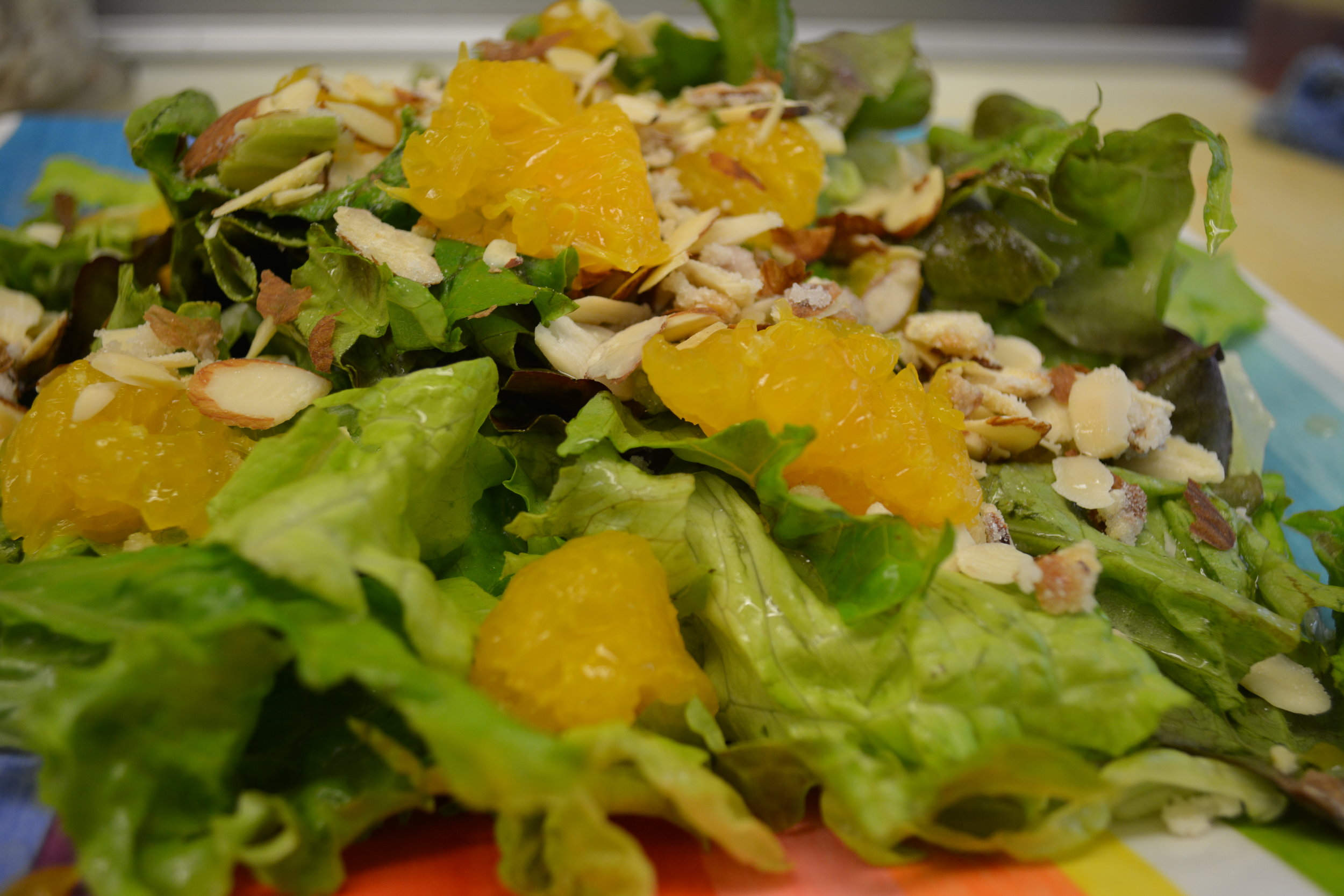 CAFE - Red and Green leafy lettuce, mandarin oranges, and carmelized almonds,topped off with our homemade sweet & sour red wine vinaigrette dressing
