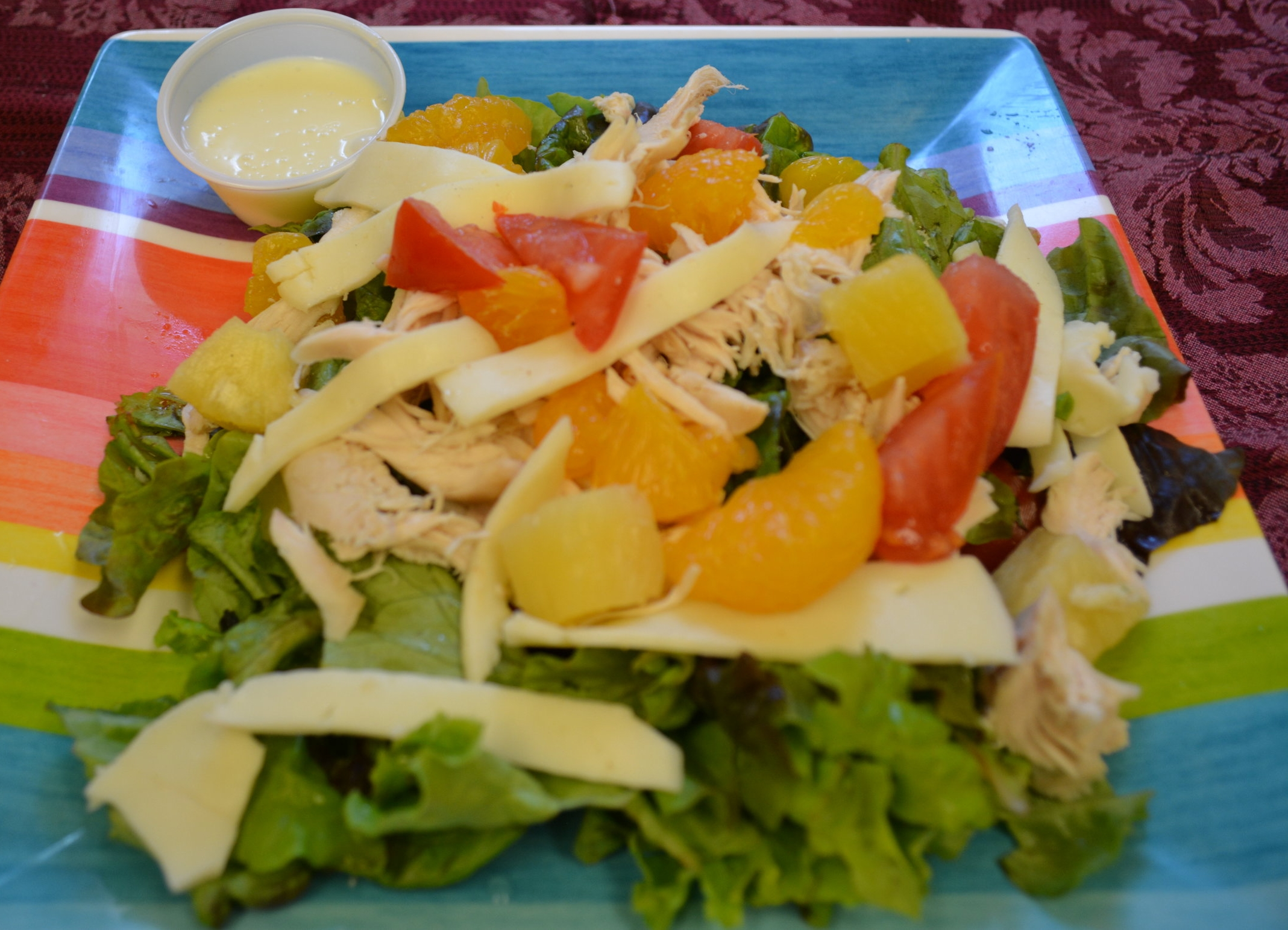 Island - Fresh lettuce, tomatoes, all white chicken breast, shredded cheddar cheese,pineapples and mandarin oranges, served with homemade lime dressing