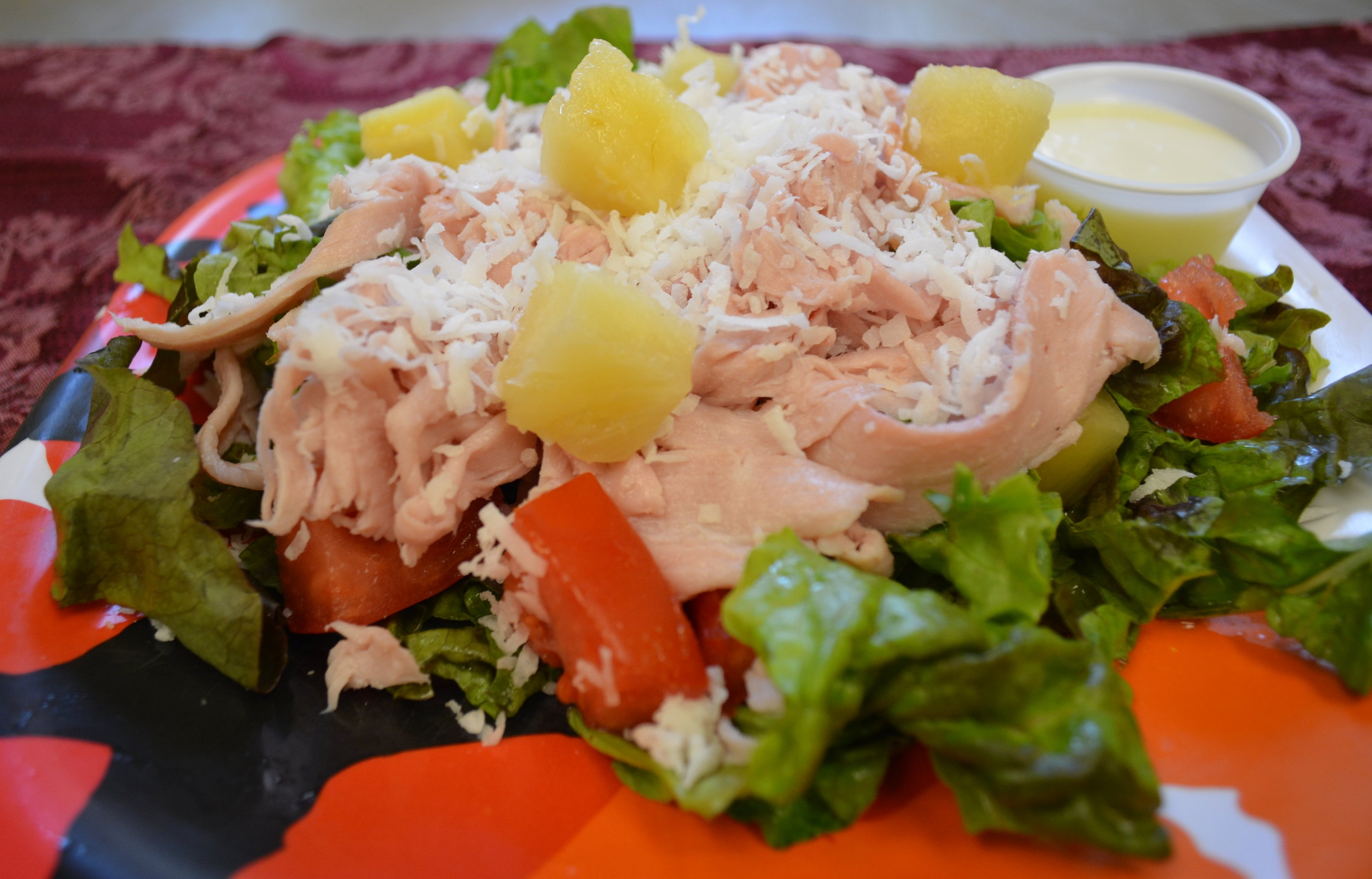 ALOHA - Fresh lettuce, ham, pineapples, tomatoes,and shredded coconut, served with homemade lime dressing