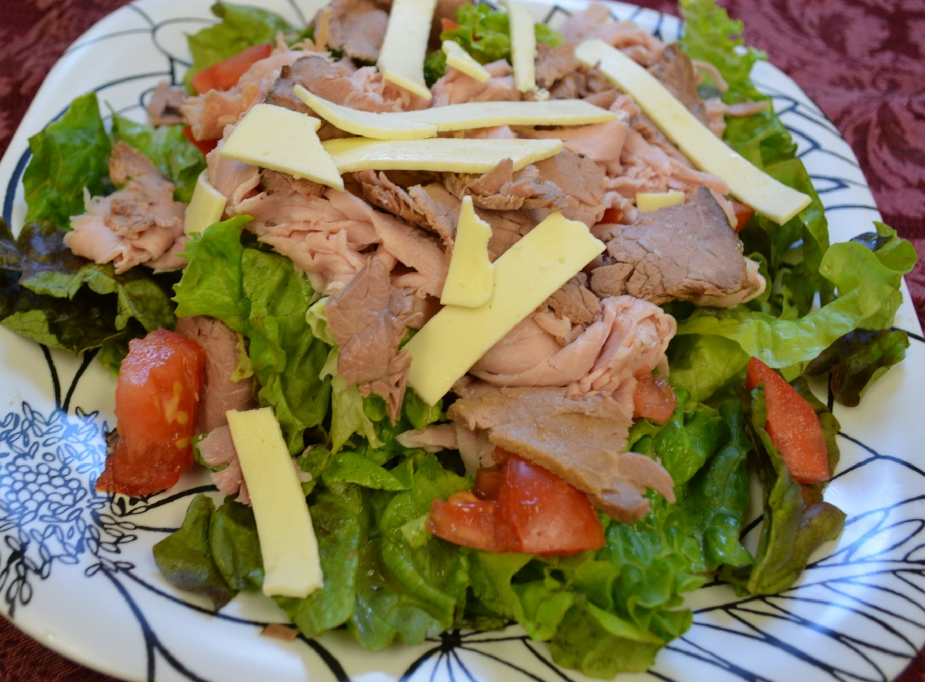 Chef - Fresh lettuce, Tomato, Ham, and Roast Beef, topped off with provolone cheeseand your choice of dressing