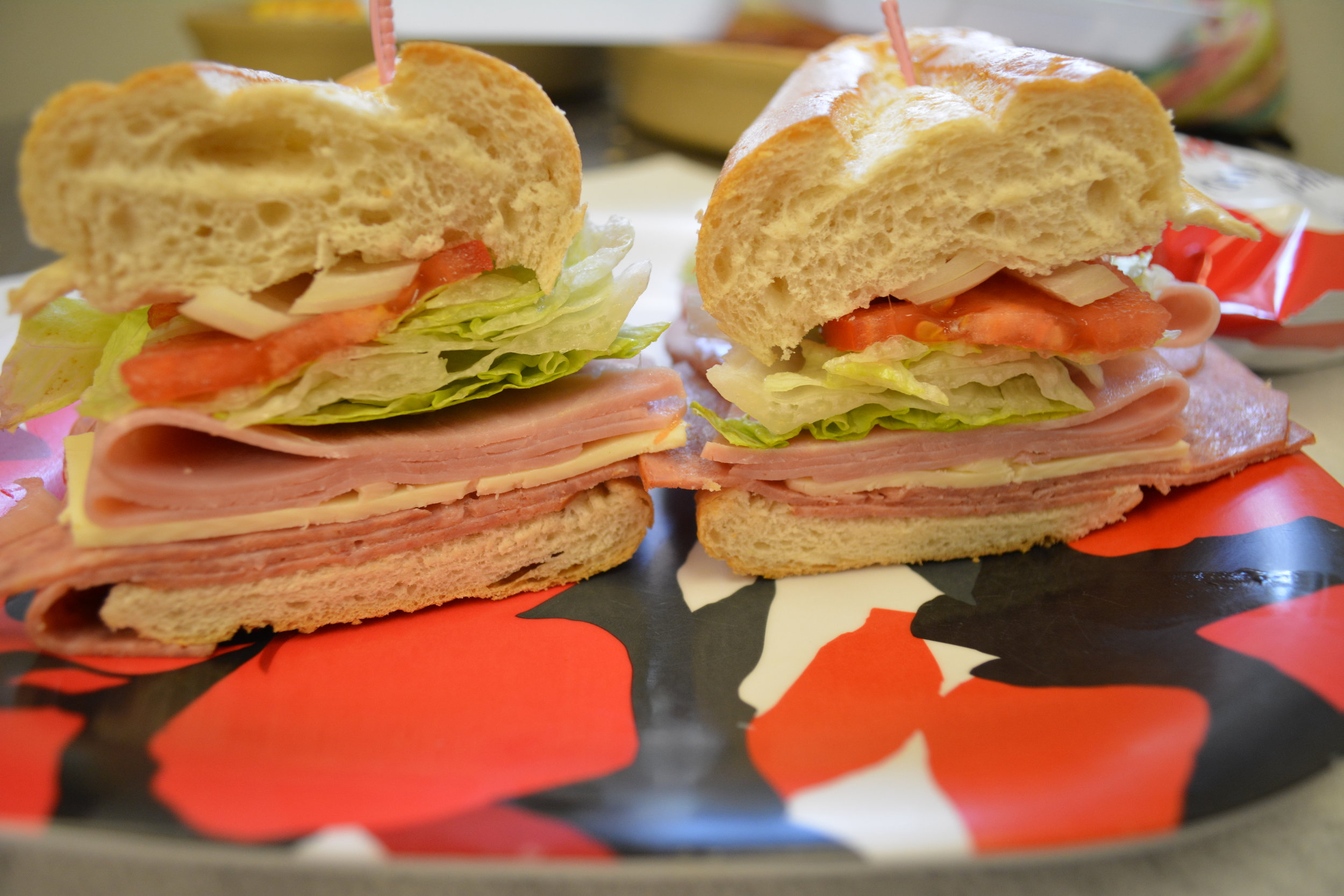 T&C Submarine - Ham, salami, cheese, onion, lettuce, tomato with a special seasoning with mayonnaise or Greek dressing