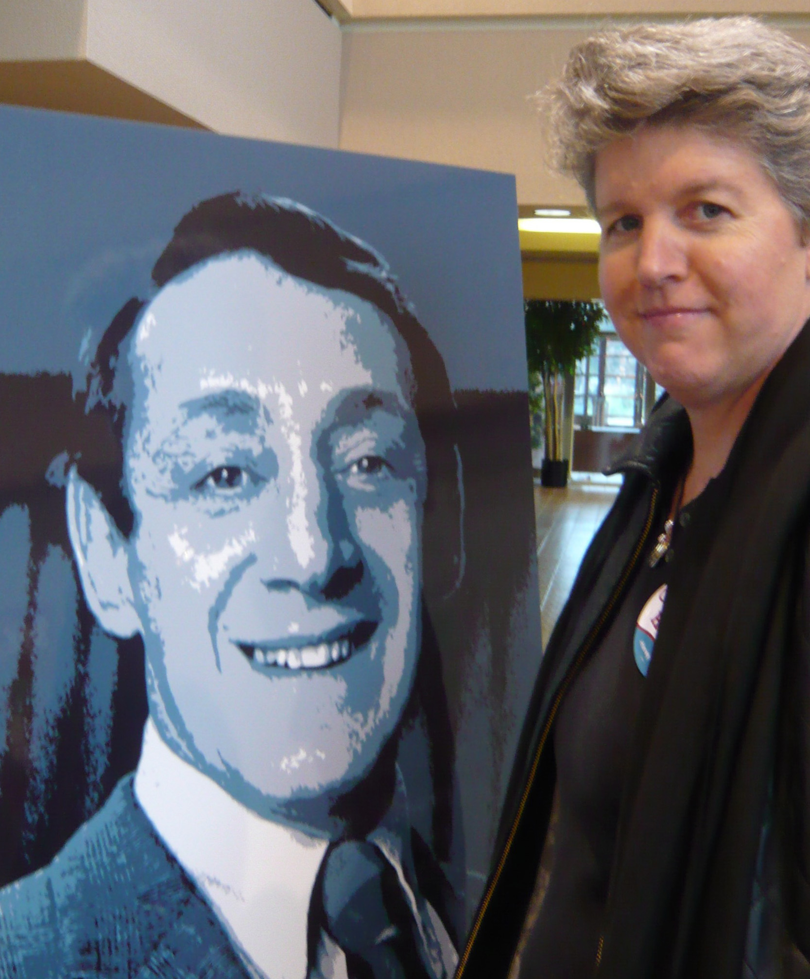 Patty with an image of Harvey at the naming of the Harvey Milk Memorial Administration Building at the Treasure Island Job Corps Center, November 25, 2008.  Read more .