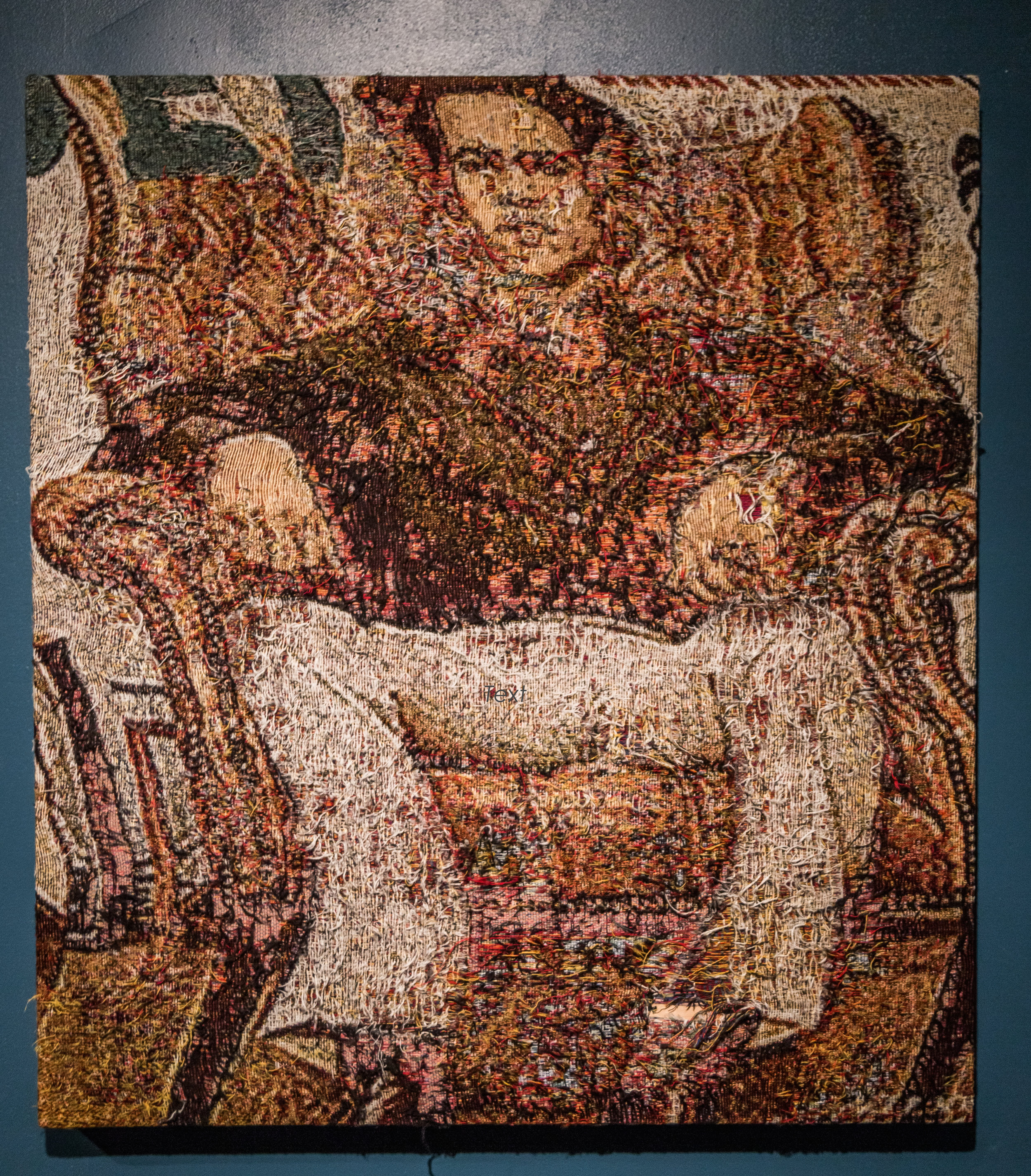 """This (Huey Newton Jet Mag Cover) , 2016-2017, Distressed, stretched Jacquard tapestry, 40"""" x 36"""""""