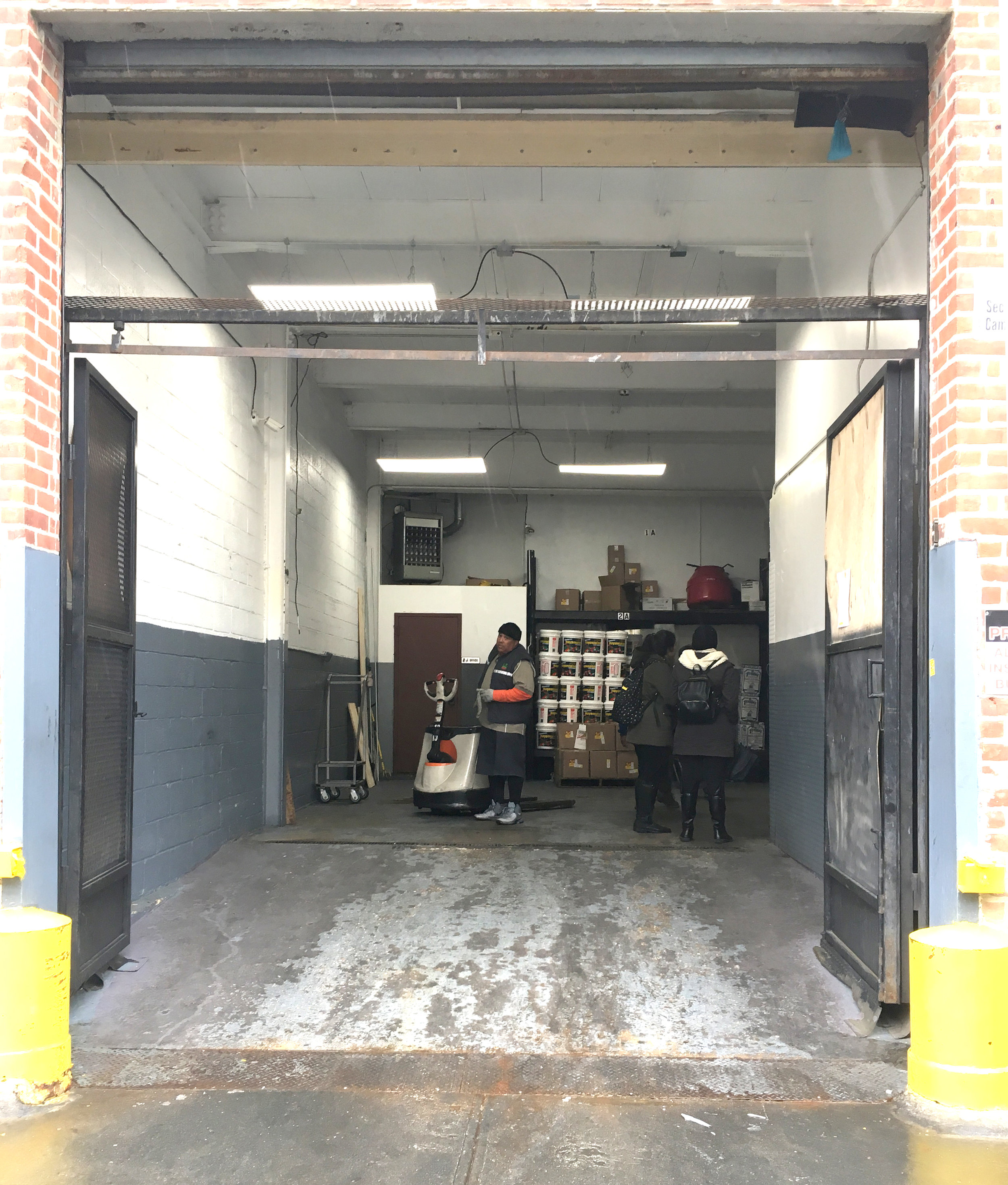 Entrance of the Halal Guys' kitchen warehouse in Astoria, Queens. All Halal Guys' food carts are brought here every night to be washed and stored.