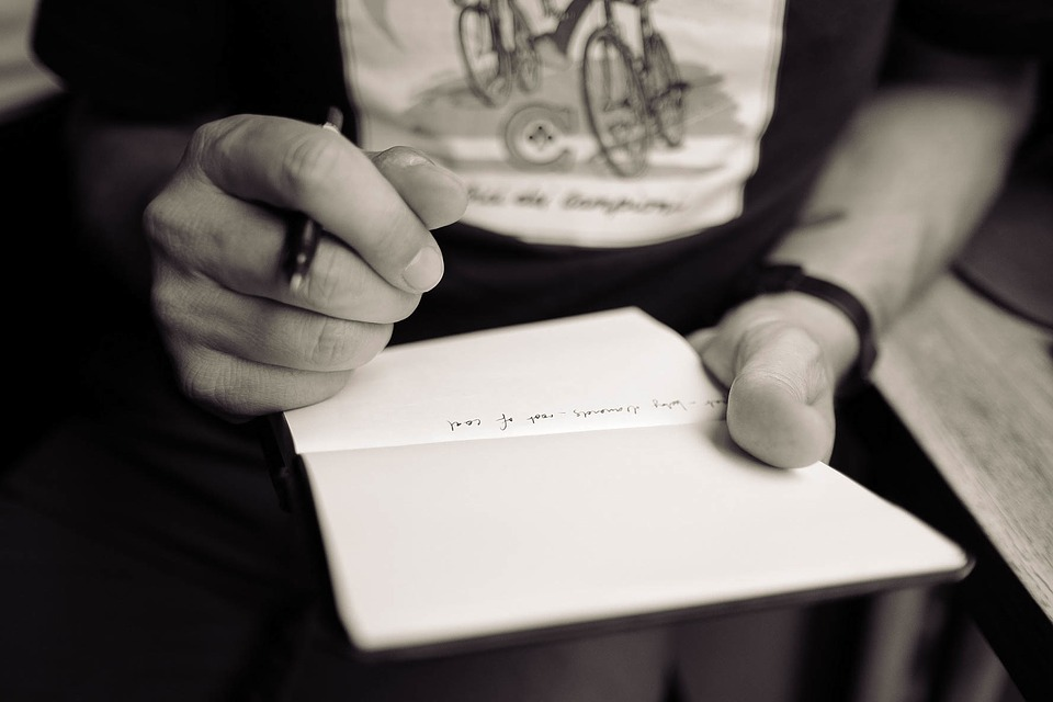 Hands and notebook