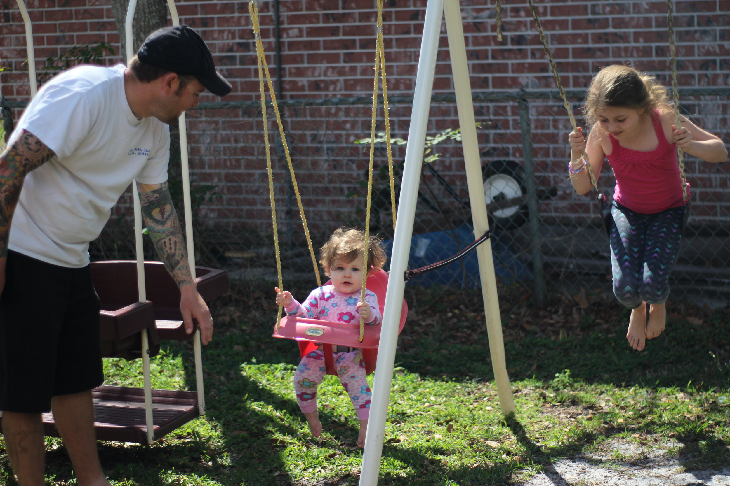 Vandegrift watches his two daughters play on their playground in his backyard.