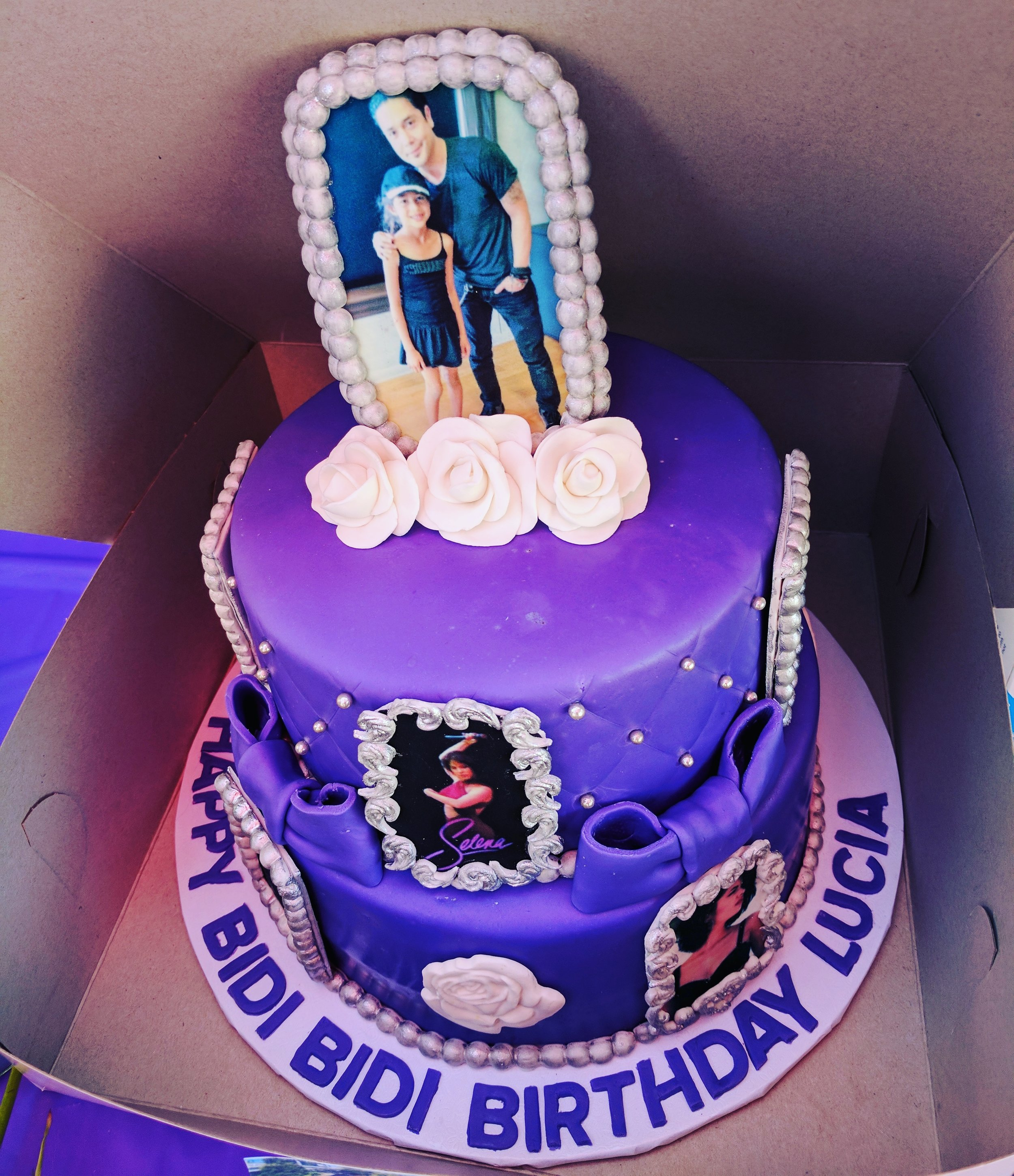"""Lucia pictured with the late singer's husband Chris Perez on the """"Bidi Bidi Cake"""" topper. (Selena's famous song """"Bidi Bidi Bom Bom"""" has become an anthem of sorts during Latino parties)."""