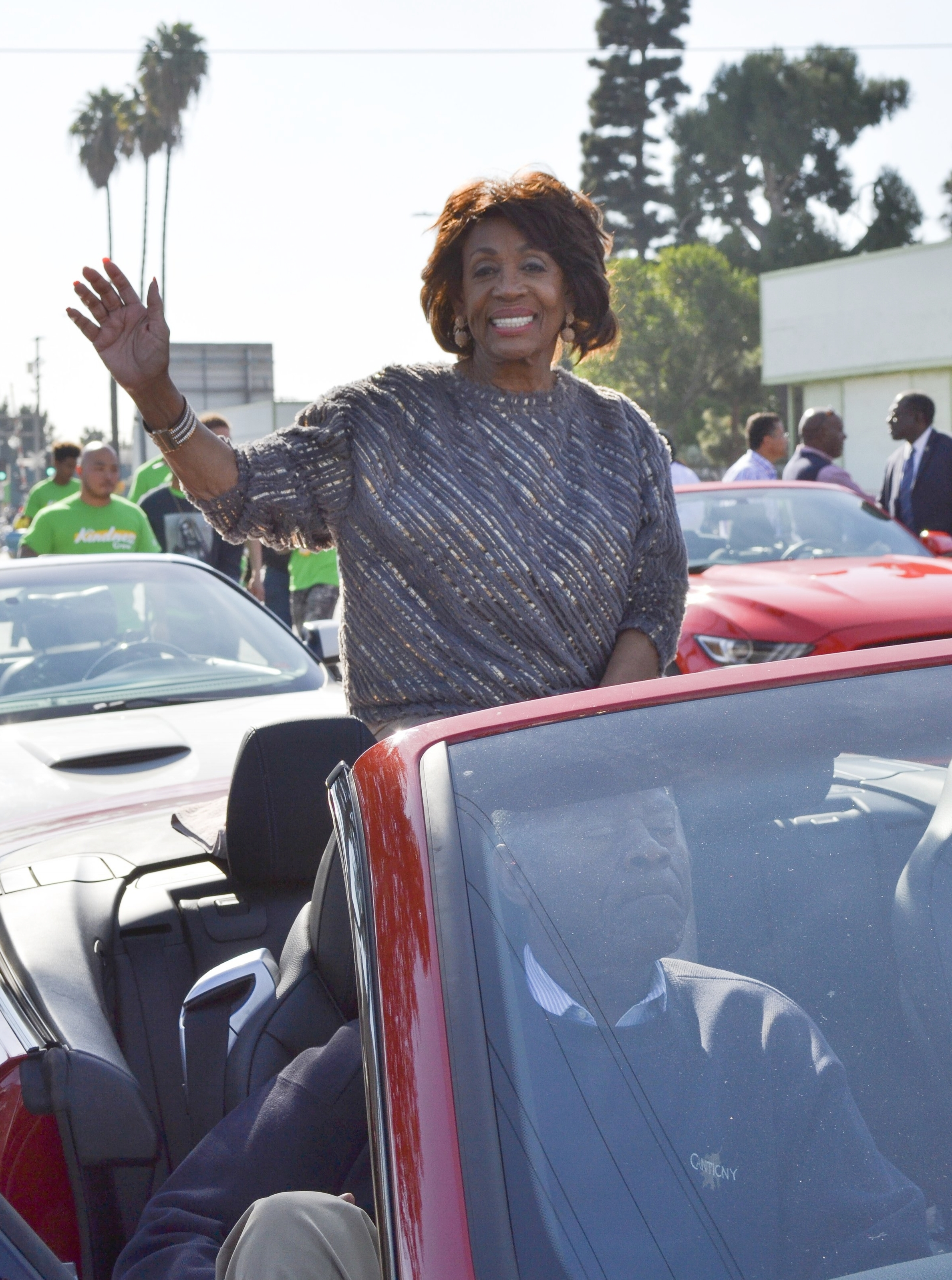 Congresswoman Maxine Waters (D-CA 43) waves at the crowds during the 52nd Annual Watts Christmas Parade on Saturday, December 2, 2017.