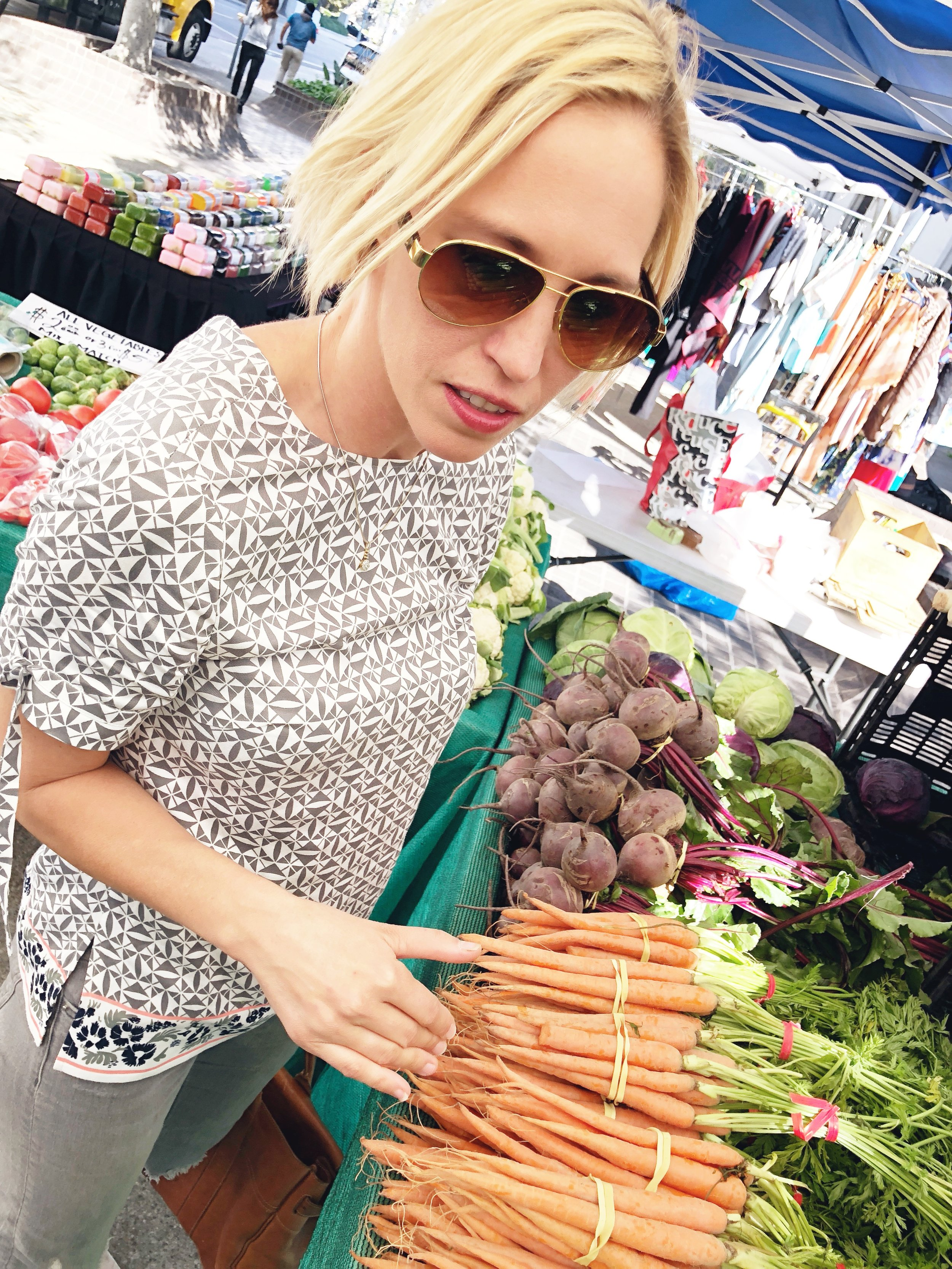 Kerstin explains what she looks for in shopping for fruits and vegetables during a trip to a Farmer's Market in Downtown Los Angeles.