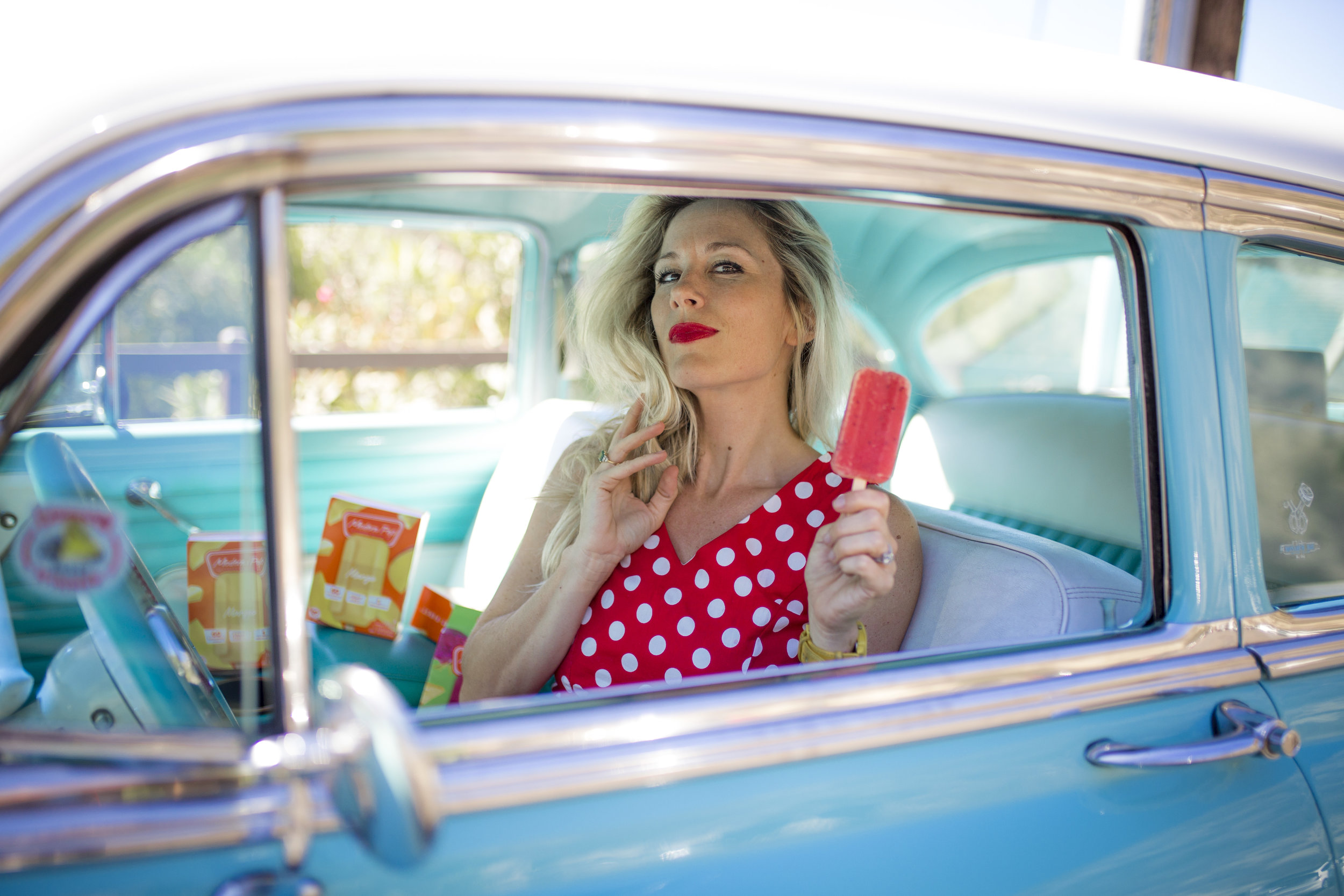 Podolec poses in a 1954 Chevy BelAire Sedan owned by Gil and Bernie Travis, for Mommy In Los Angeles Magazine's photo shoot in Laguna Beach.