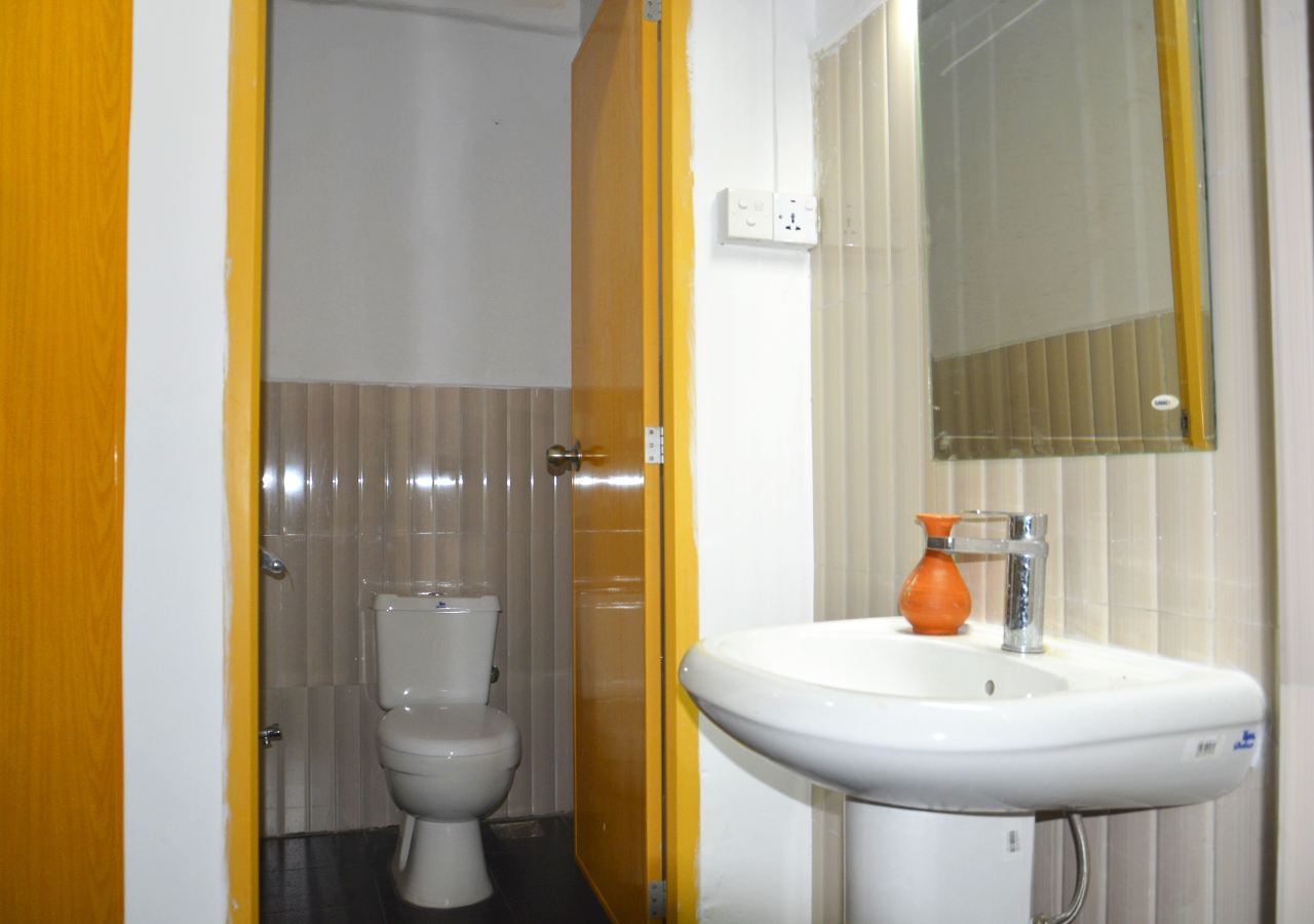 Sink and Toilet in Male Bathroom