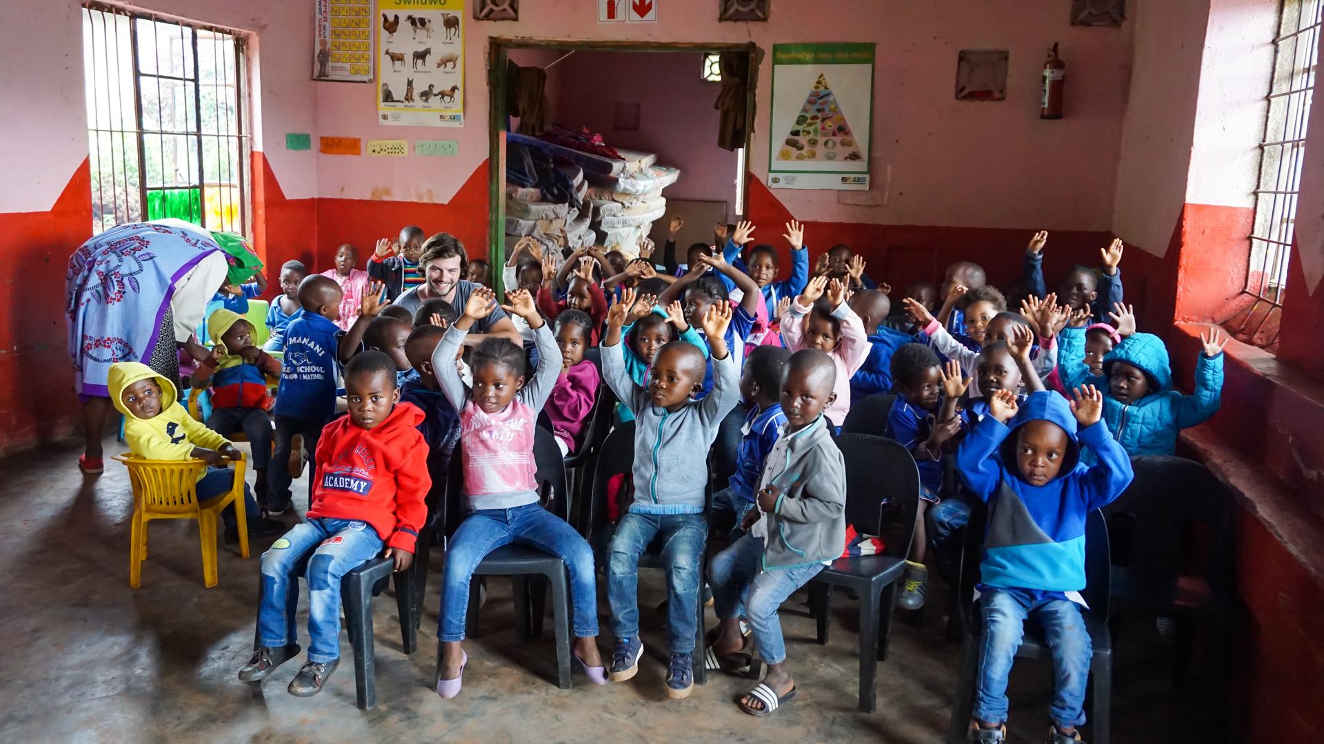 School kids next door to the textiles workshop