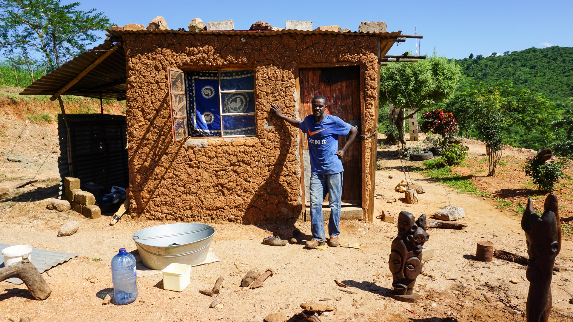 Paul outside his hut overlooking he Limpopo countryside