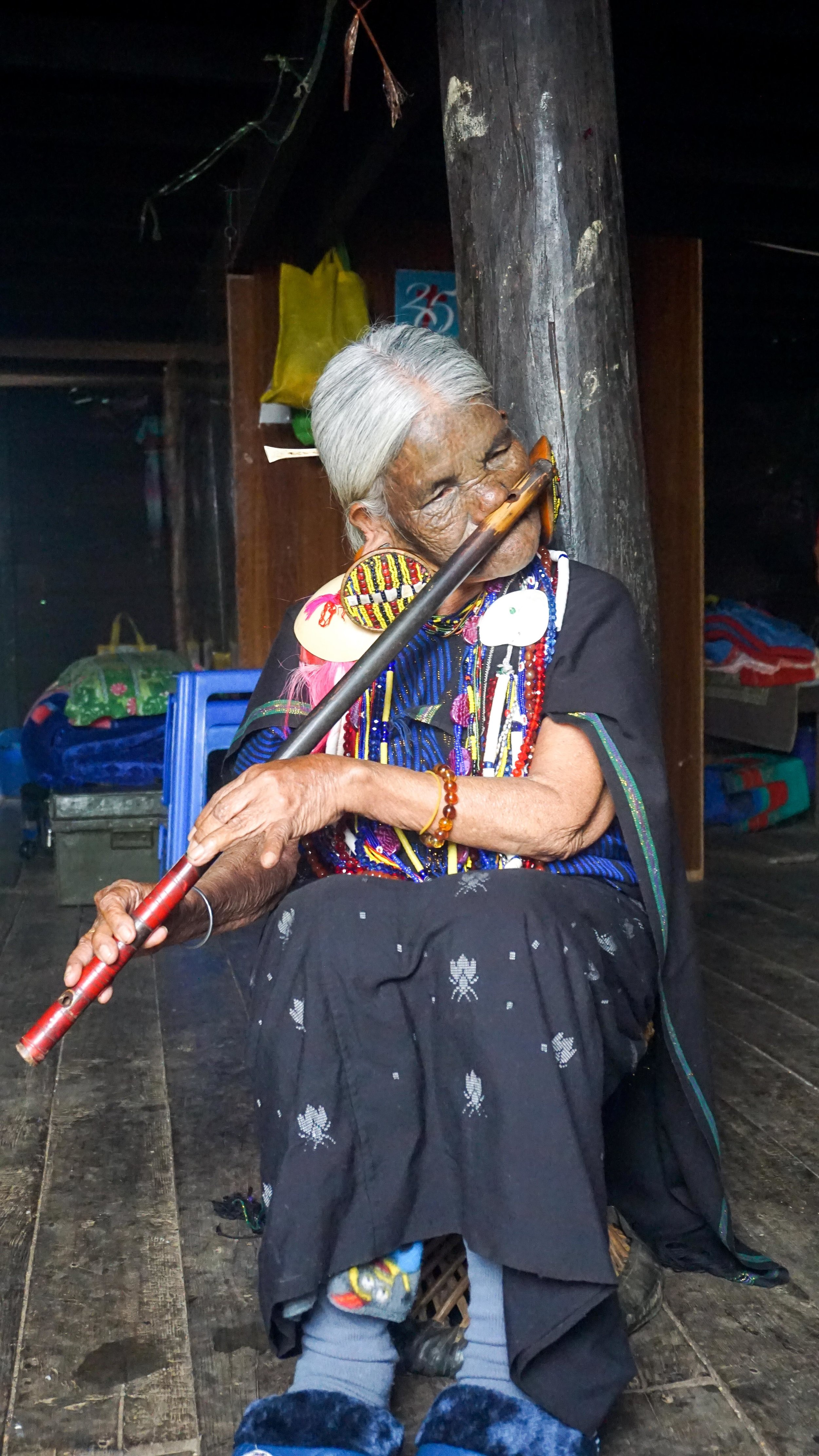 The famous tattoo-faced, nose-flute playing lady of Mindat