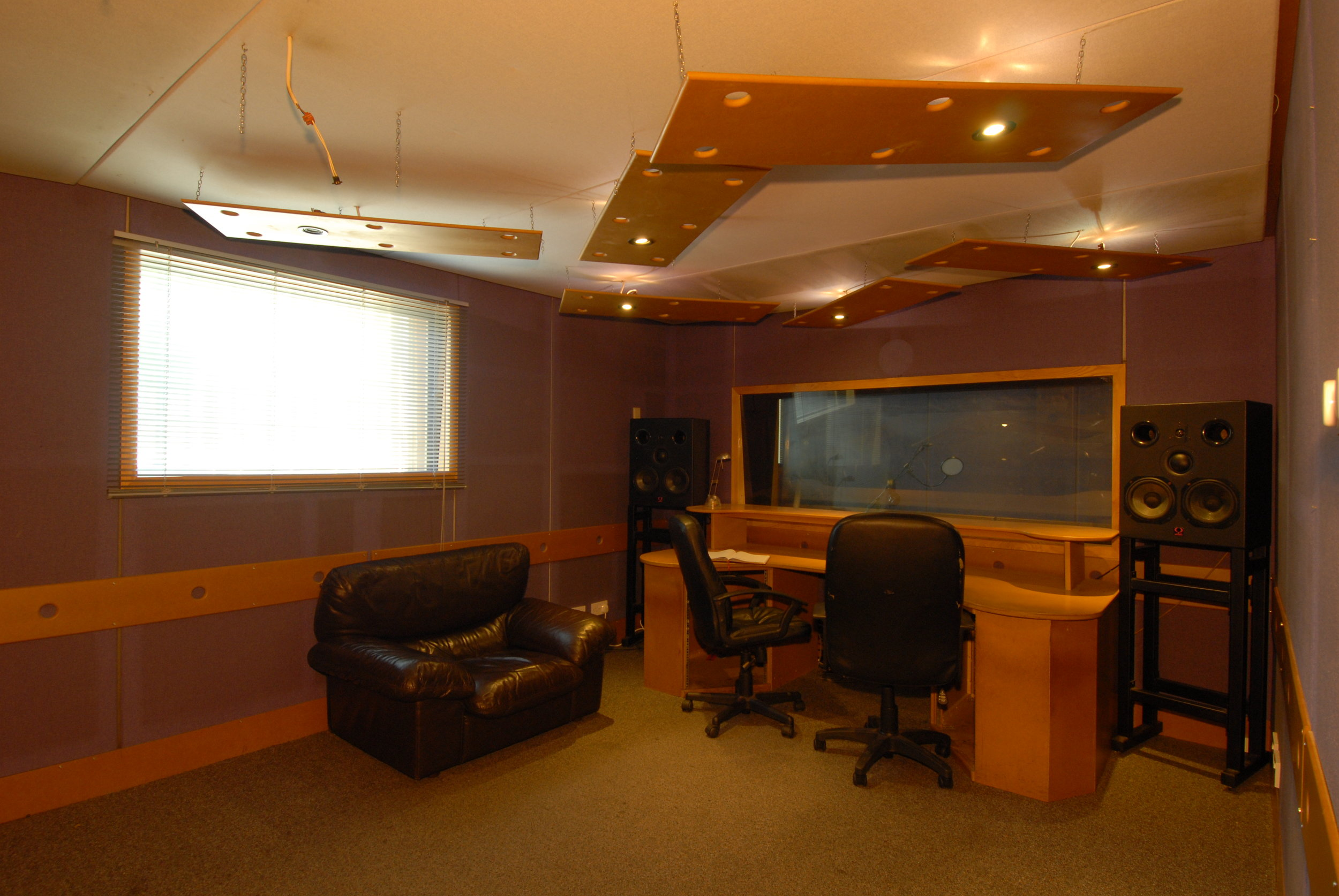 Studio 1 - Designed and built by KFA, production suite 1 is an ideal mixing, programming, recording and production space with natural daylight. It has a separate booth large enough for a drum kit. It is air conditioned (silent), sound proofed, tuned to 100hz, has quadruple glazing and is independently alarmed.Measurements: 3.6m wide by 4.8m long. Vocal booth: 3.6m wide by 1.8m long.