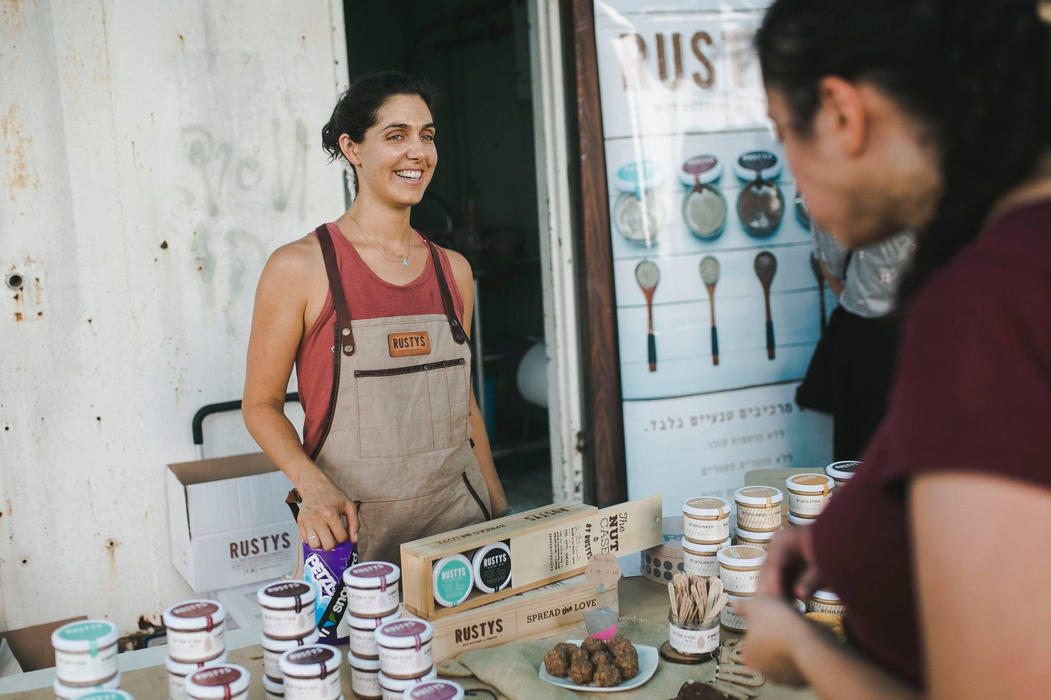 Beautiful Tal selling her wares at a local market
