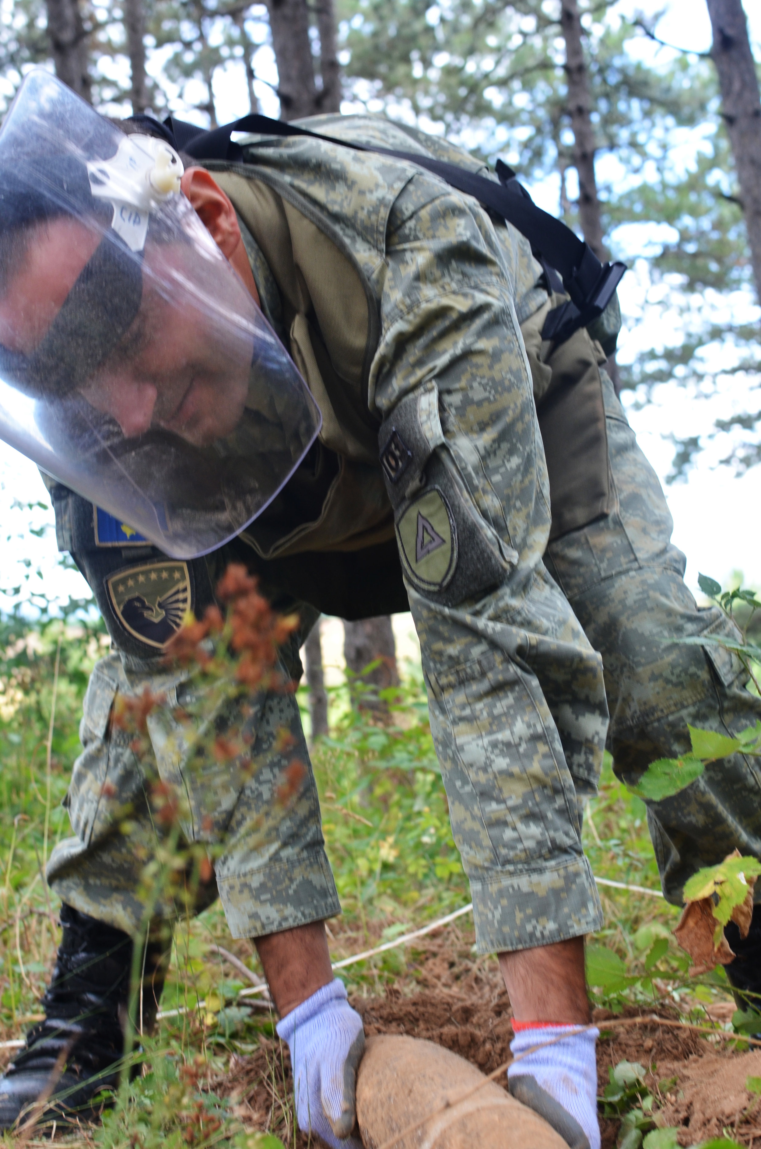 A Member of the Kosovar Security Force removes a mine in south west Kosovo.