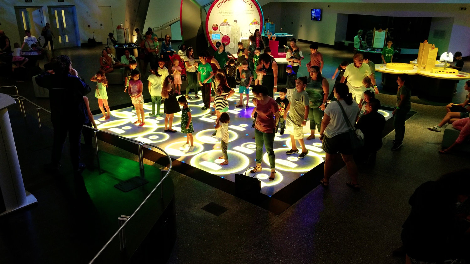 Kids and adults playing a calorie burning game on the ActiveFloor.