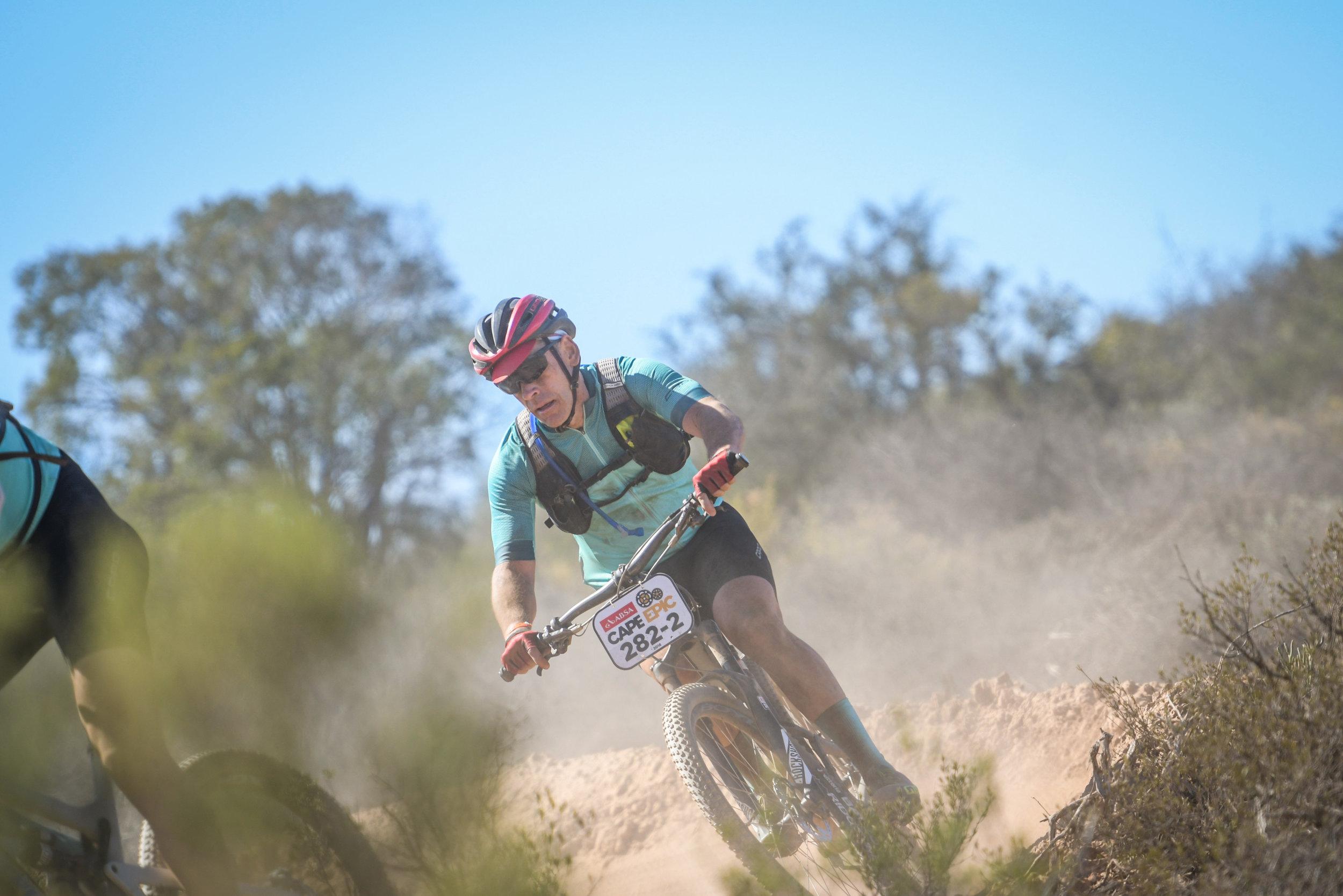 I rode Cape Epic with a prototype Camelbak hydration pack called the Chase.  It sits higher on your back and allows the rider to utilize your jersey pockets.  It is perfect mountain biking.