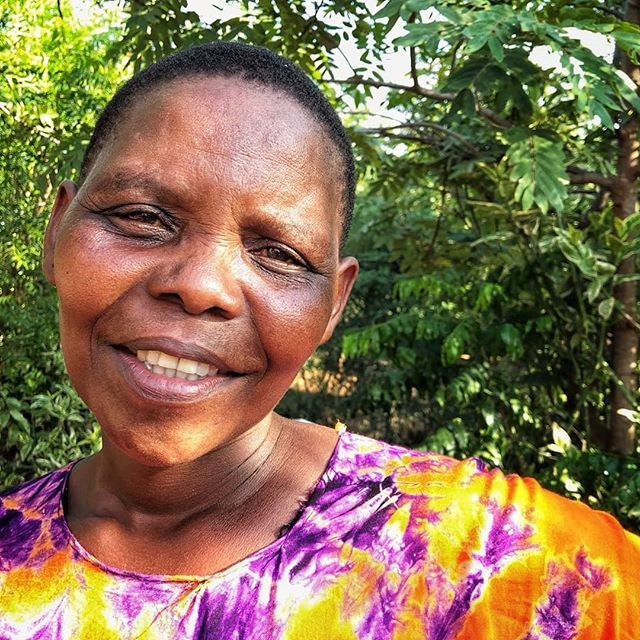 This beaming beauty is Suzani, wife of one of our Health Activists, Joseph. Joseph works in the RC district of Kikavu and is getting such excellent results supporting the community that we recently were able to give 9 families their cards to the clinic 💕 . . . 📸 Behind the lens @alexandra__smart 📸 . . . #portraits #mothers #healthamplifier #humanity_shots #culture #tanzania #eastafrica #peopleoftheworld #storiesofafrica #throughtheireyes #peoplephotography #makeadifference