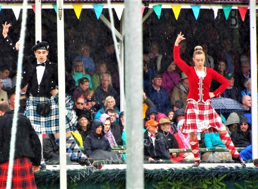 Rain doesn't dampen the spirit of the dancing competition during the Scottish Highland Games at the Braemar gathering.