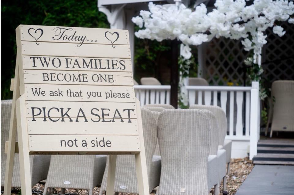 Available for hire is our handmade aisle seating sign painted in Ivory with hand painted writing. This will complement any rustic/outside wedding and give your aisle décor that bit of Wow.