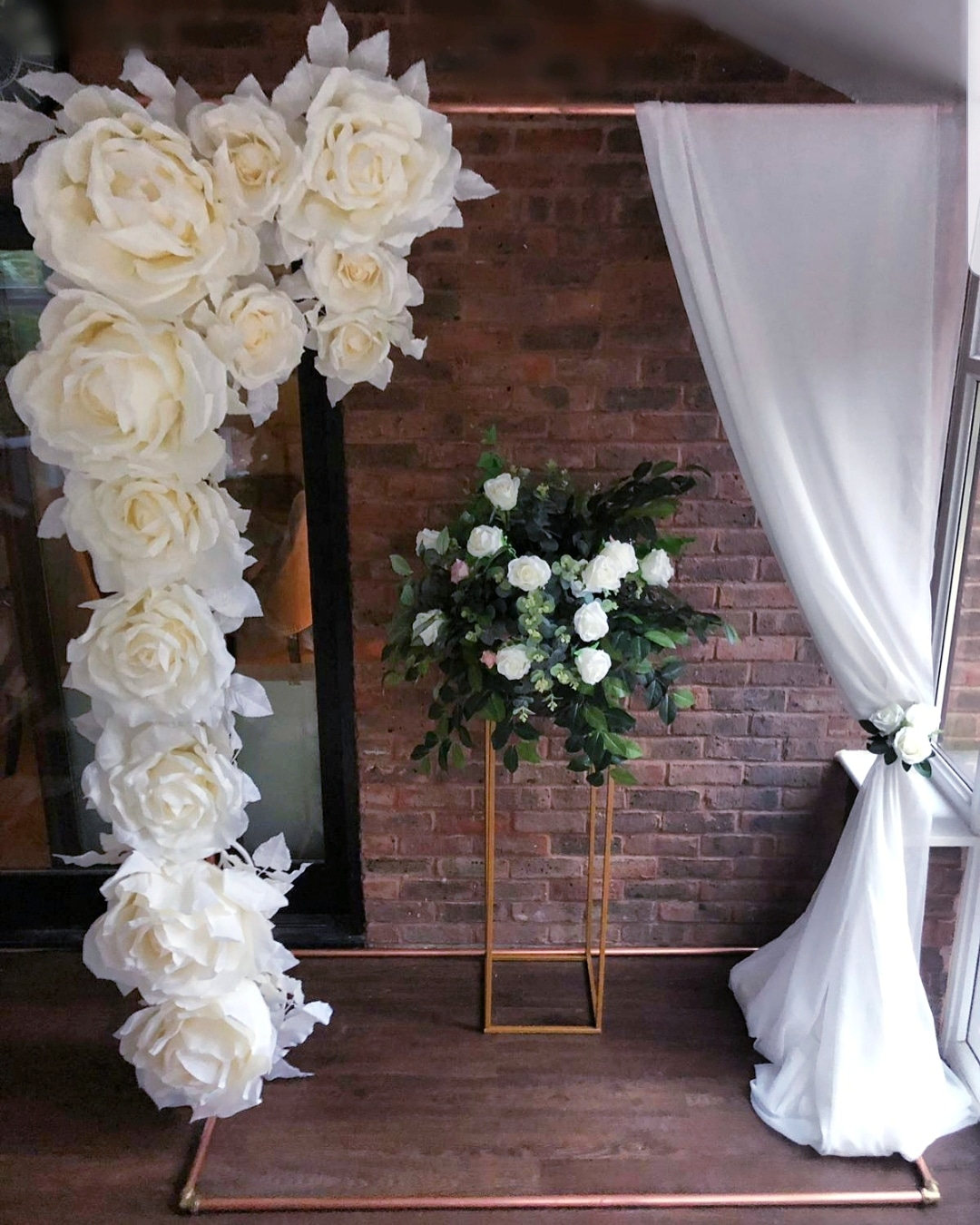 Copper frame - Our copper frame can be dressed with our large ivory roses and drapes, or covered with an array of foliage to create a truly stunning backdrop for your event.Also this frame can be teamed with our White Neon flex 'Happily ever after' signSize of copper frame is 220cm tall x 160cm wide x 90 cm deep