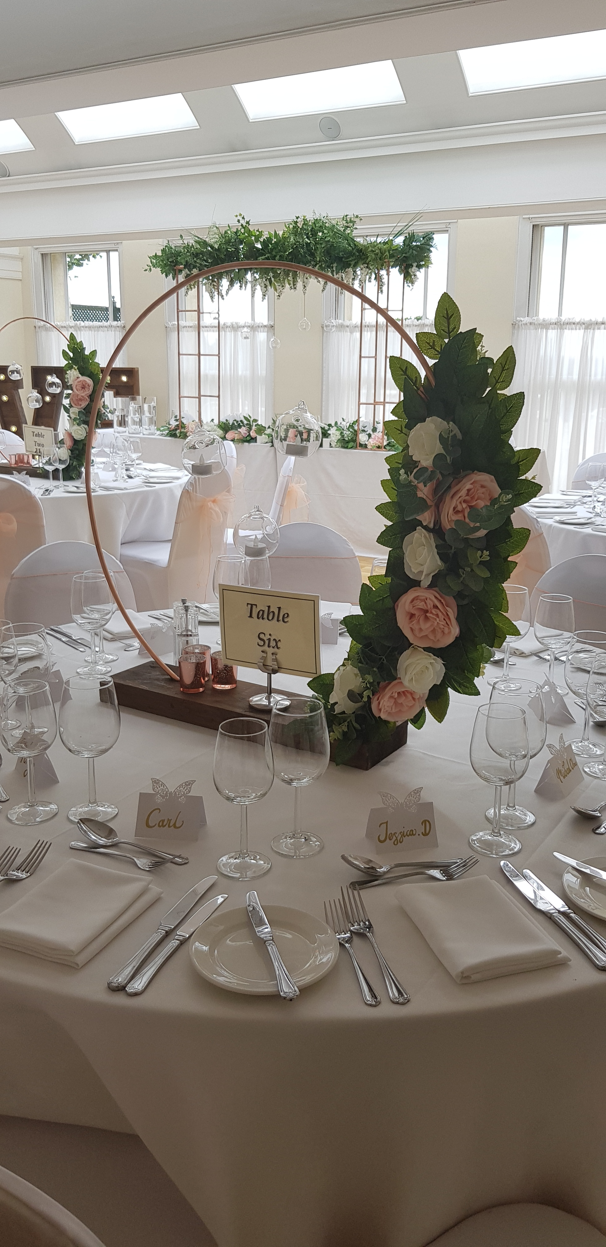 Copper hoop centrepiece - These truly beautiful copper hoop centrepieces are a must have for your 2019/2020 wedding. Dressed with our stunning silk flowers and foliage with hanging LED candlelit baubles.We have a selection of 600mm diameter and larger 800mm diameter hoops available.