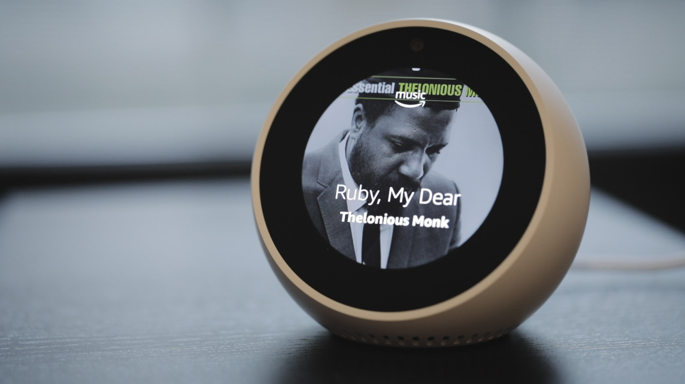 """Echo Spot - This cute little guy sits on our nightstand and has numerous capabilities such as reading the news, telling time, playing music, and has our favorite game, """"Song Quiz""""."""
