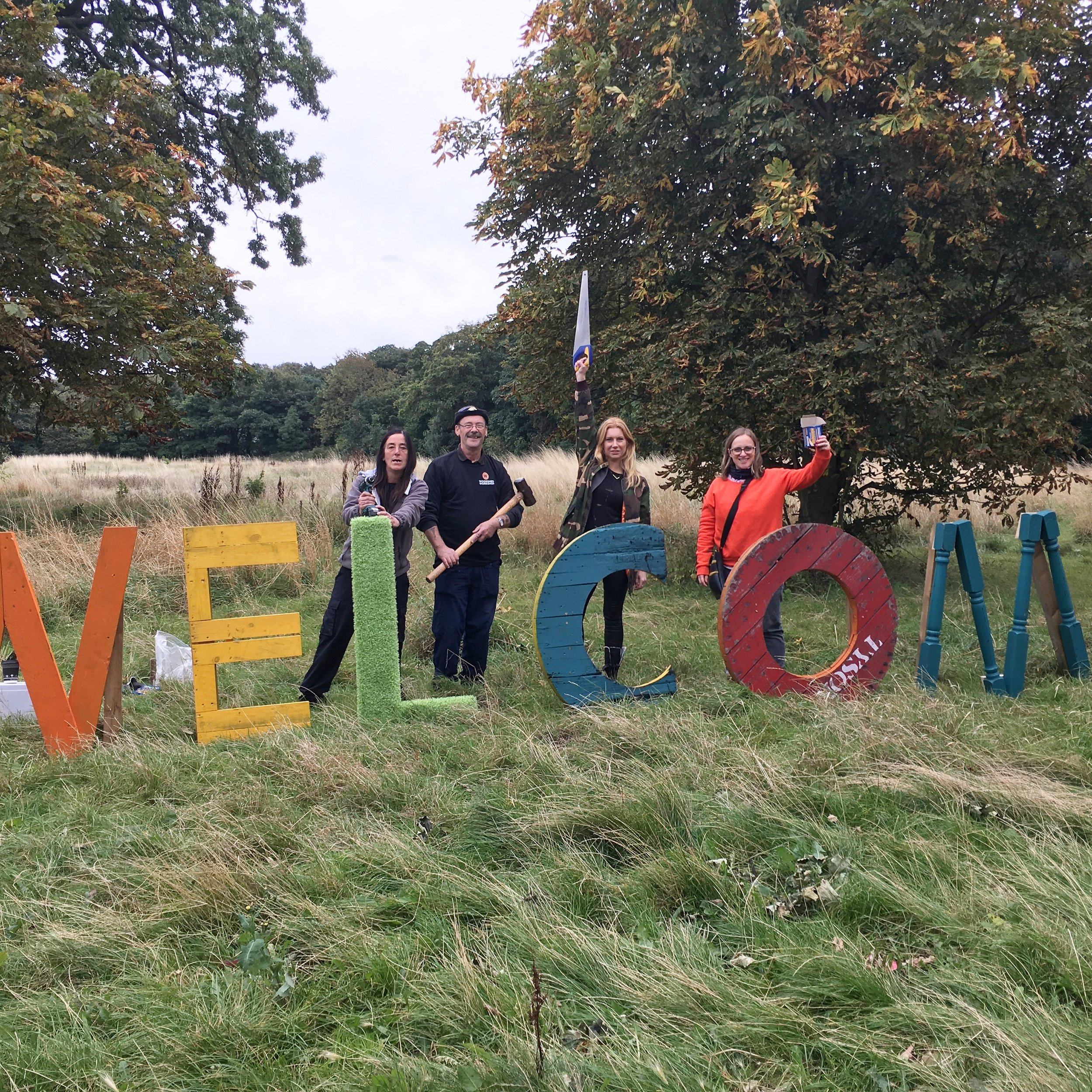 Me and the lovely Woodshed workshop lot, moments before opening building the welcome sign!