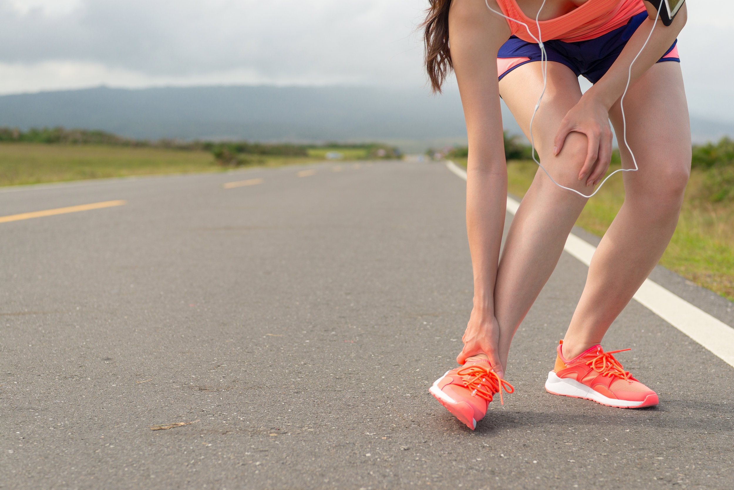 bigstock-Female-Athlete-Ankle-Injury-Wh-199041655.jpg