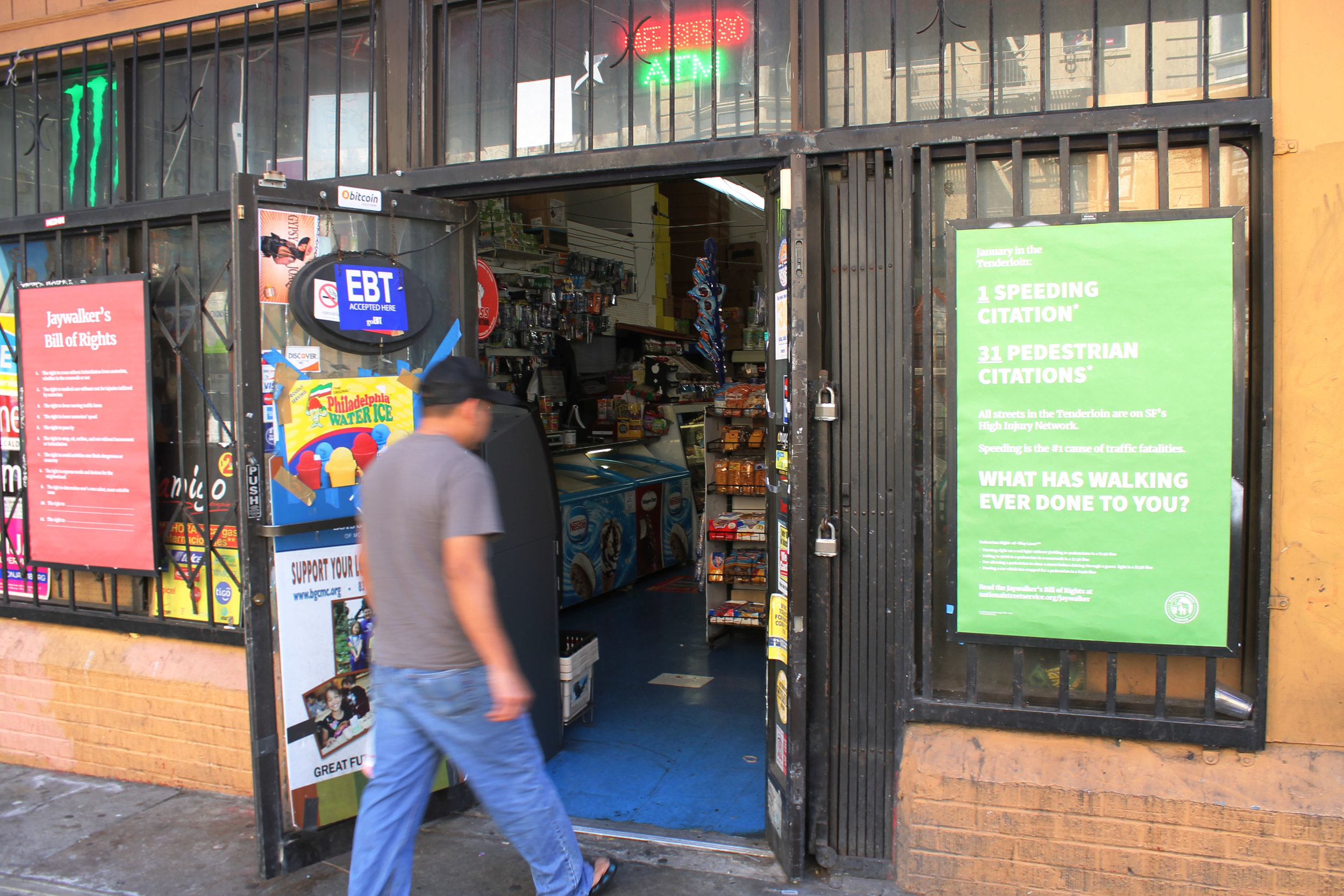 Two Jaywalker Bill of Rights posters on the front of a convenience store in the Tenderloin, San Francisco.