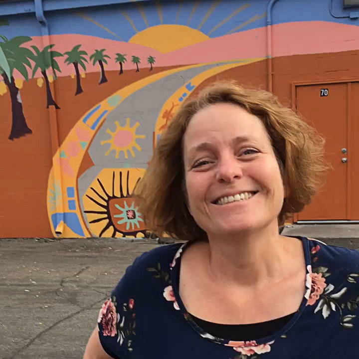 Deborah shares the story of how she organized the murals, in front of a freshly completed mural by local artist Anne Moore. Photo credit:  Diane Ronayne/TVAA