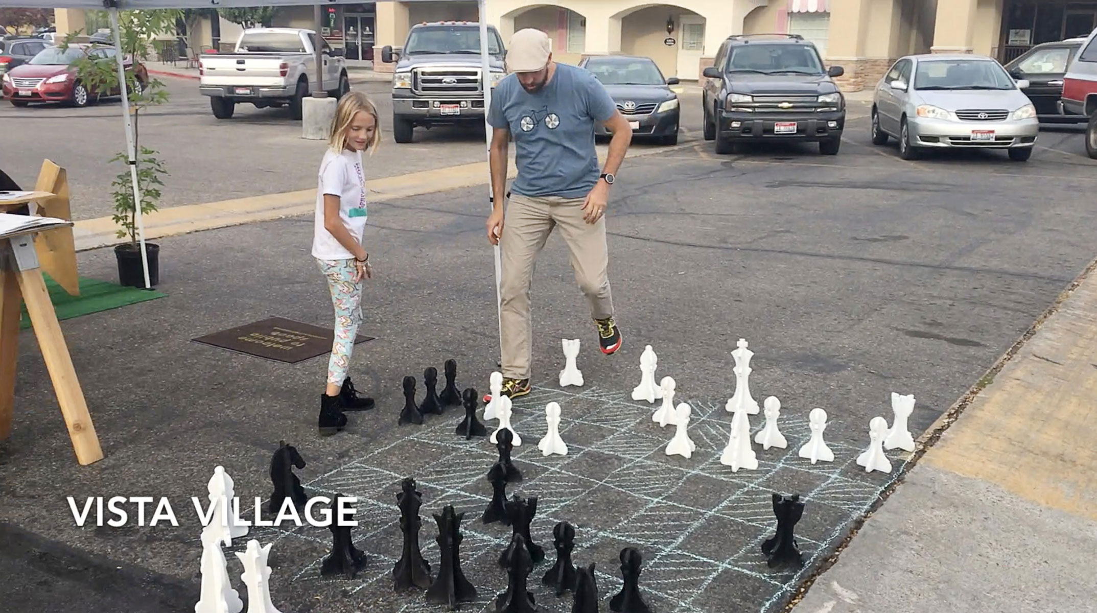 Passers by pause to play chess in Vista Village, Idaho Photo credit:  Idaho Smart Growth
