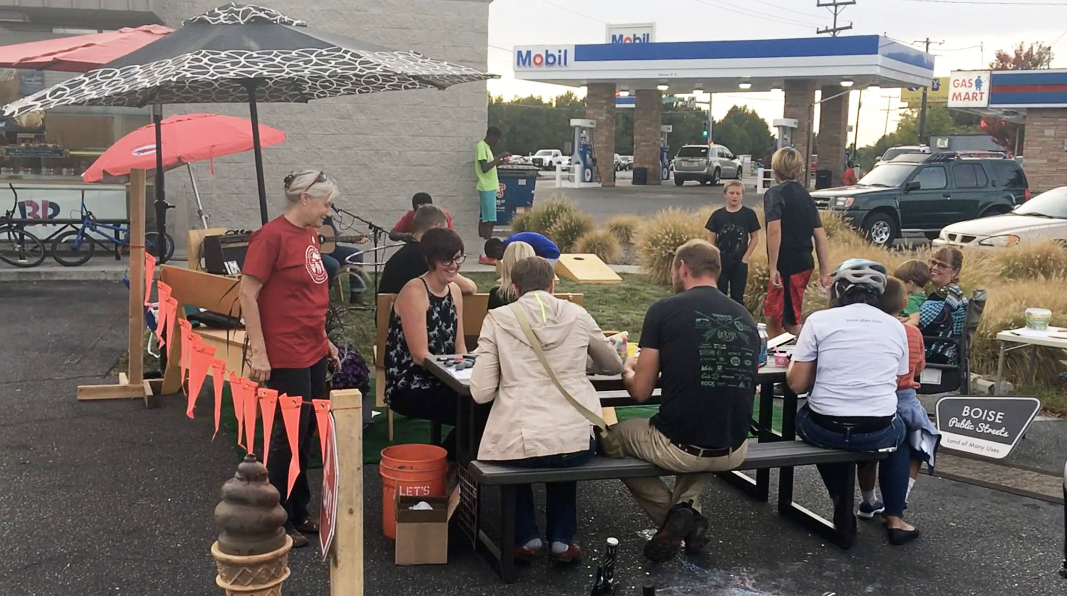 Residents of Boise's Collister Neighborhood enjoy the parklet's activities, games and music.  Photo credit:  Idaho Smart Growth