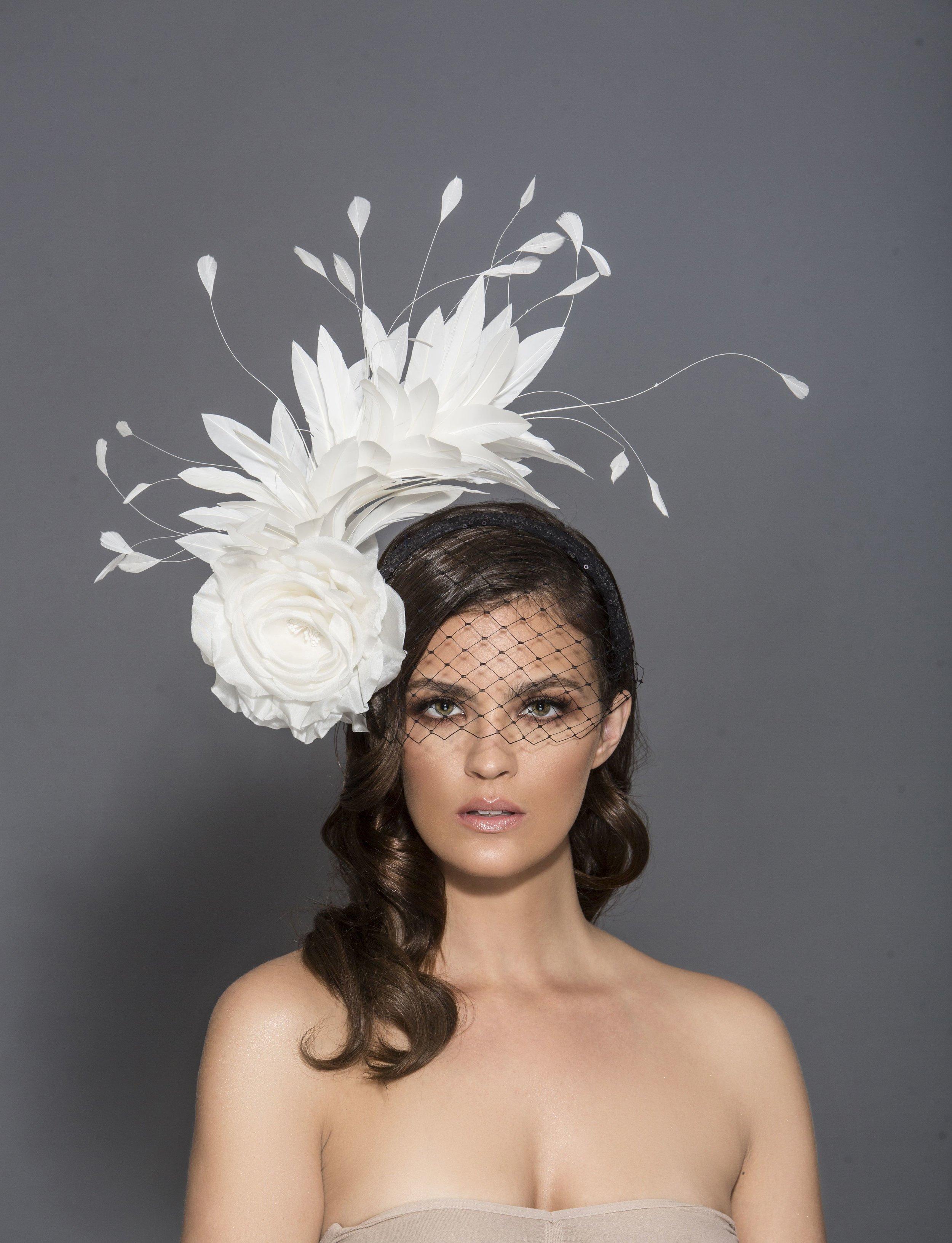 Hat designer: Arturo Rios  Photographer: Mark Sacro  Makeup: Dominique Lerma  Hair: Tuyen Tran