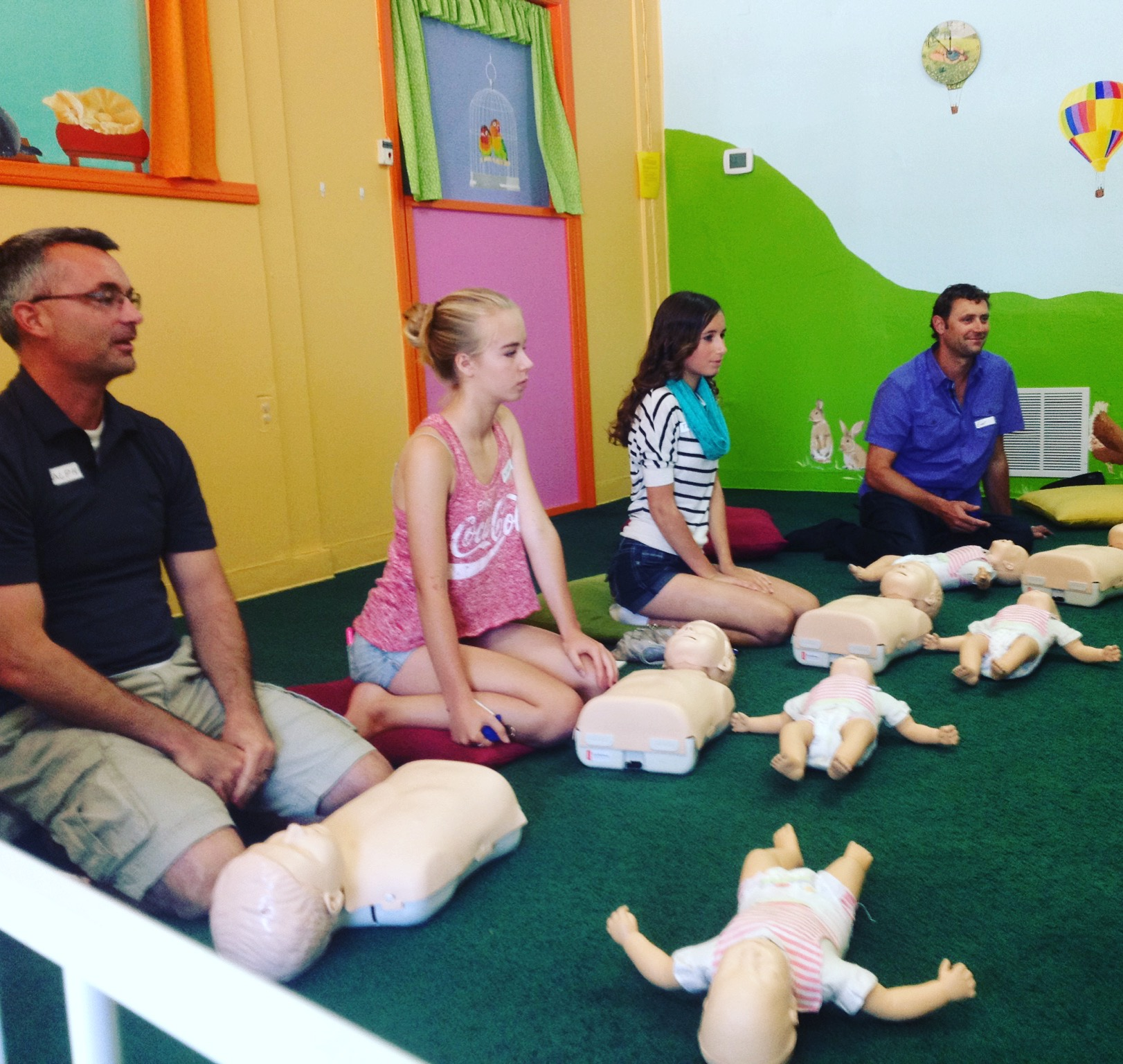 Parents and Teen Baby Sitters at Baby Garten Studio in San Diego Learn Lifesaving Skills at Infant and Child CPR and Choking Relief Class