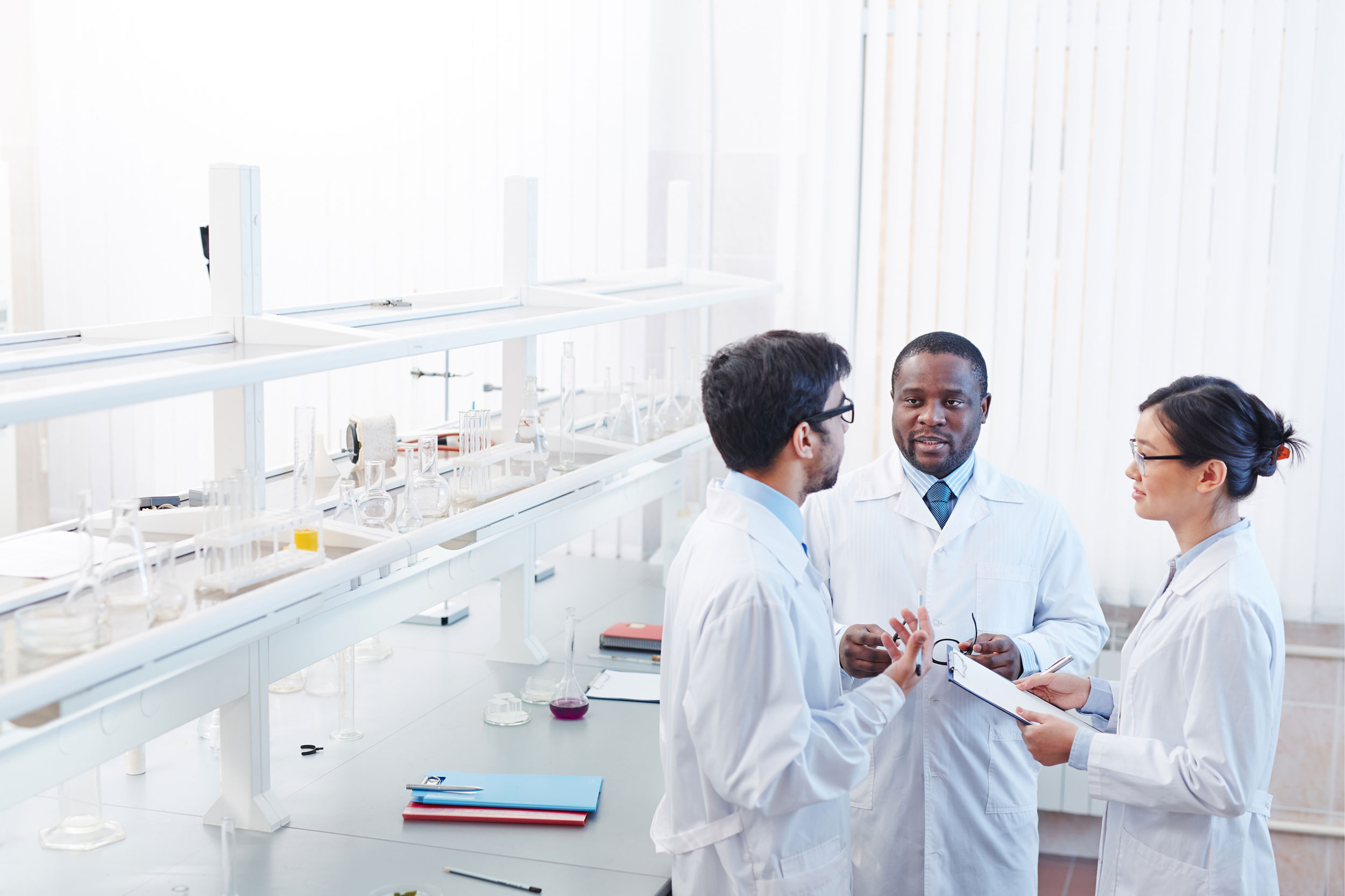 stock-photo-high-angle-shot-of-pleased-male-african-american-male-latin-american-and-female-asian-laboratory-475109248.jpg