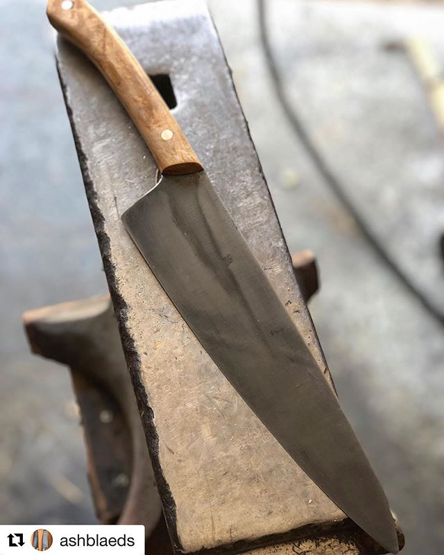 Wow look at this amazing knife our friends @ashblaeds made. ・・・ Nearly done with @recess4907 Greg Hardesty, considered by many to be The Godfather of the Indy Food scene. This piece, ordered by @lil_missbrightside is a 1095 hammer forged gyuto with @indyurbanhardwood olive ash burl handle and a hammered in tapered tang. Simple, elegant, functional.  #hammerforged #handmade #chefknife #kitchenknife #gyuto #local #custom #indy #indianapolis #foodie #giftsforhim #artisan #craftsman #woodisgood