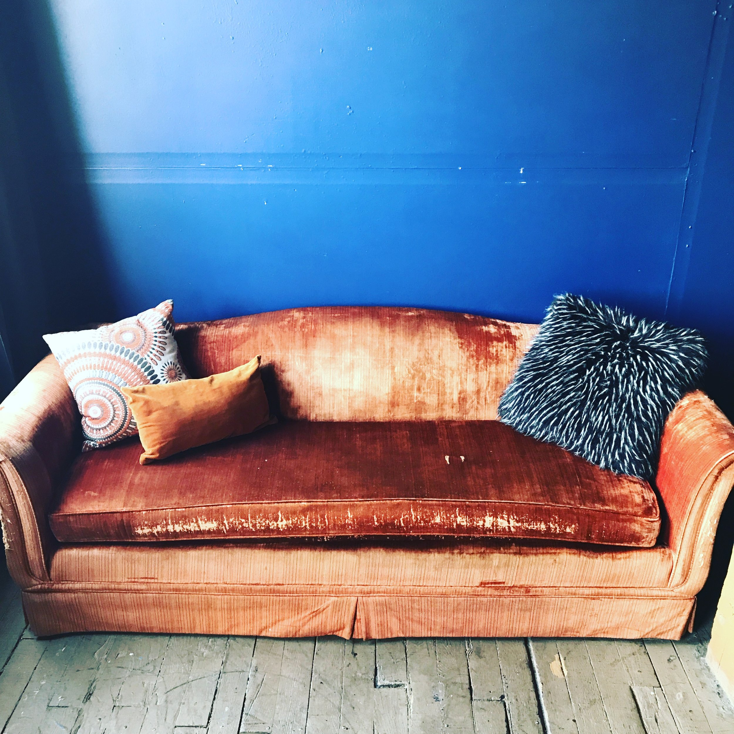 blue wall-orange sofa