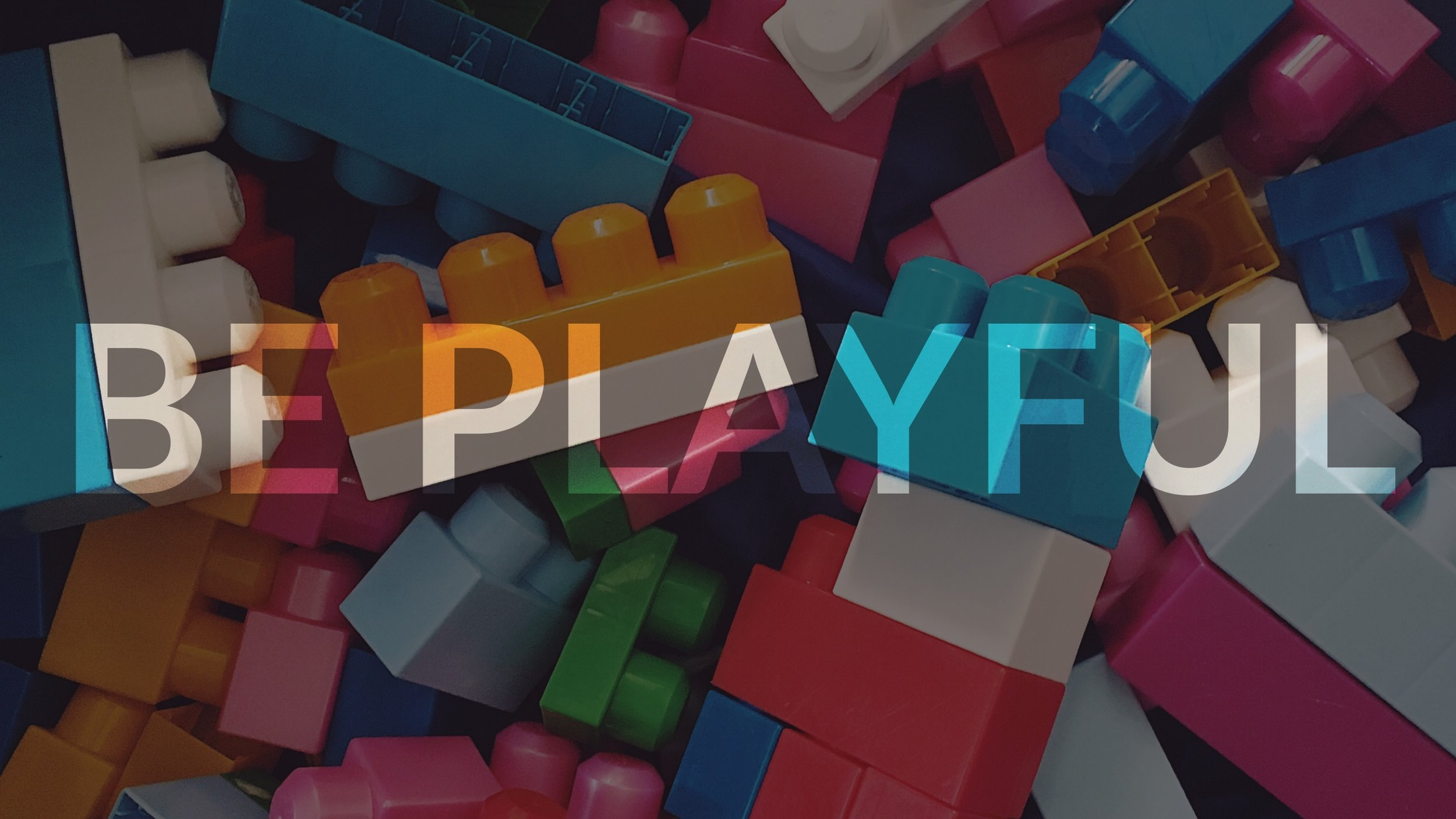 "Image of lego bricks with the words, ""be playful"""