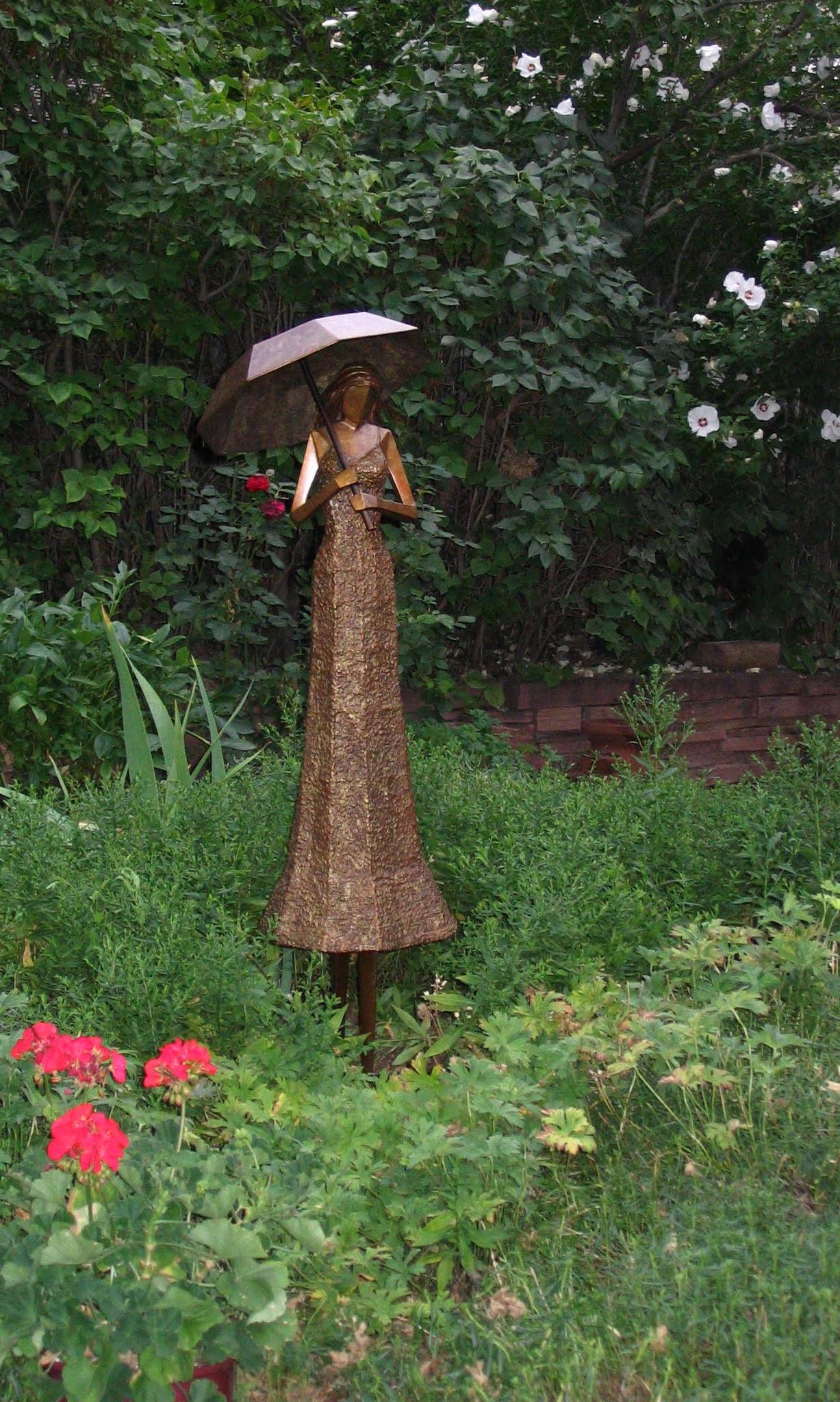 "Umbrella Girl   48"" H x 15"" W x 13"" D Bronze edition of 25"