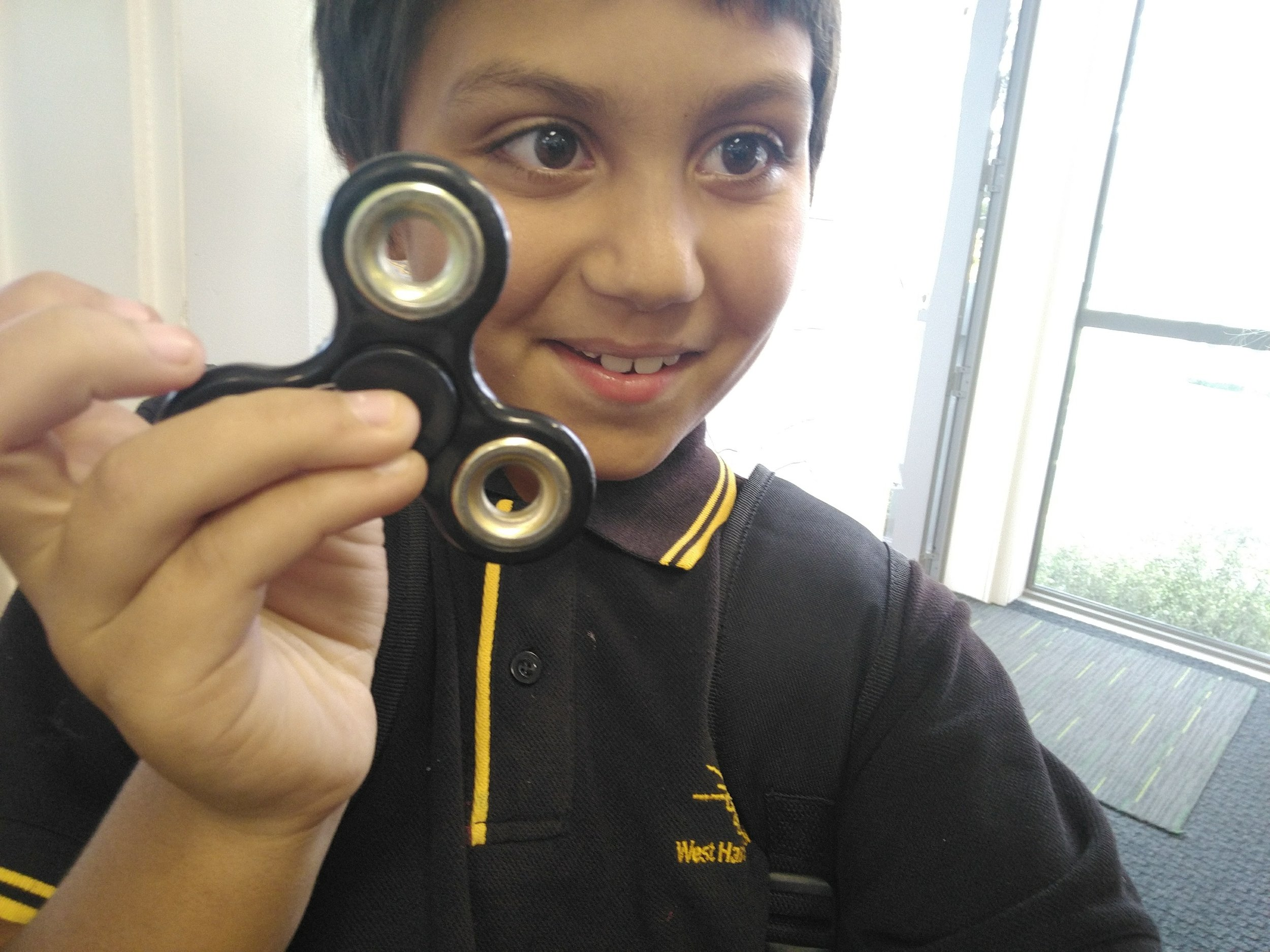 Another cool youth with a fidget spinner selfie!