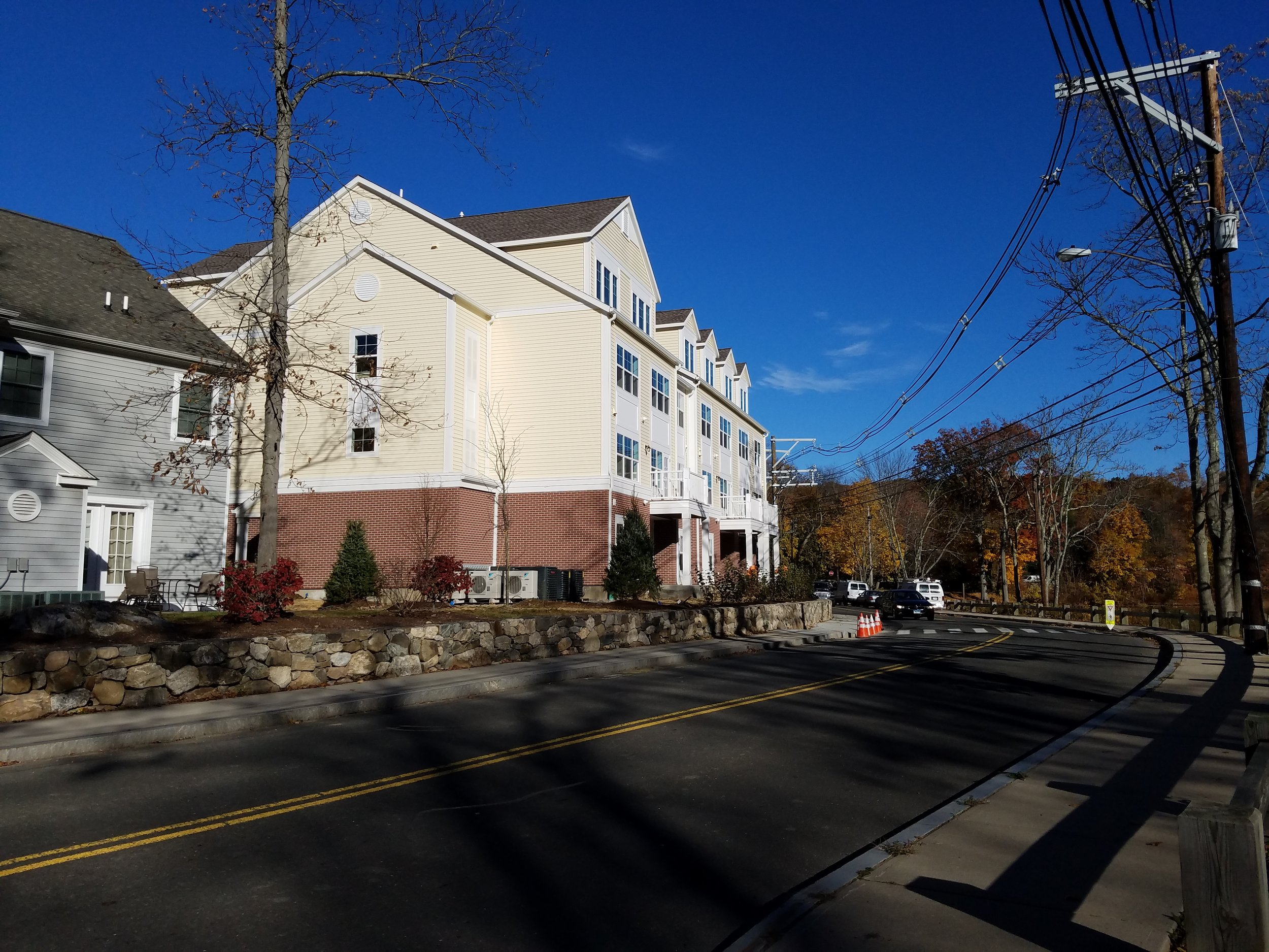 Millport Phase I - New Canaan, CT - Millport Phase I is located in a quiet residential area of New Canaan a half-mile from its lively downtown, which includes grocery stores, banks, pharmacies, a post office, a library, and many other daily conveniences. There is a pond and park across the street and an elementary school, fields and playground one block away.Role: Consultant to the Housing Authority of the Town of New Canaan (HANC)Project Type / Status: New Construction / Completed 2016Project Size: 33 units / $10.5 millionAffordability: 100% affordable to 80% of State Median IncomeFinancing: 4% Low-Income Housing Tax Credits to People's United Bank, Tax-Exempt Bond financing from Bankwell, Town of New Canaan funding