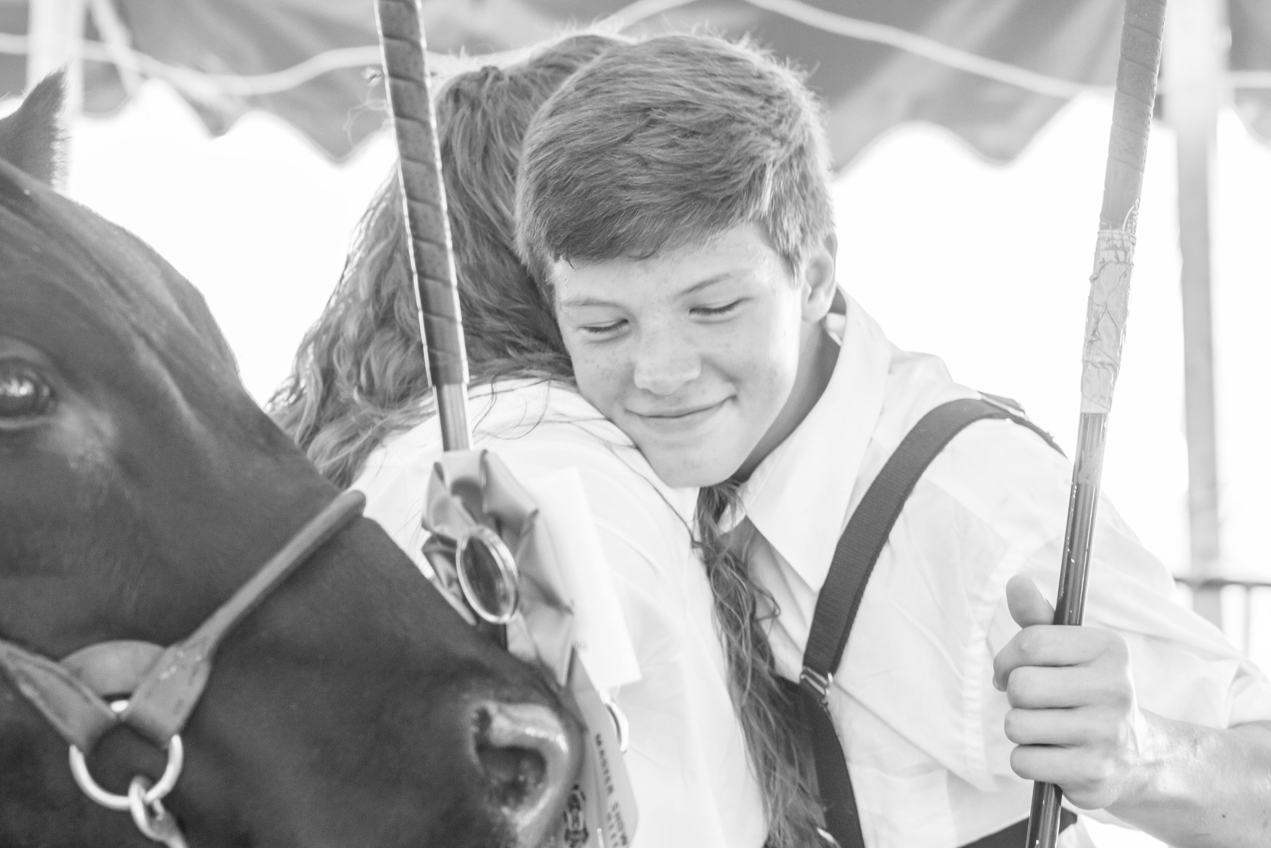 Travis Fields, hugging his long time friend, Margo Sweeney, after they won Grand and Reserve Grand Champion Steer at the 2016 Thurmont and Emmitsburg Community Show.