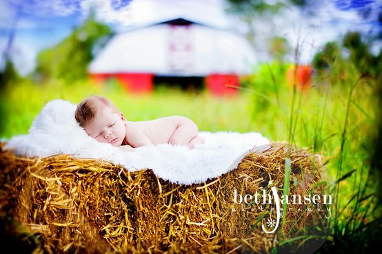 baby with big red barn.jpg